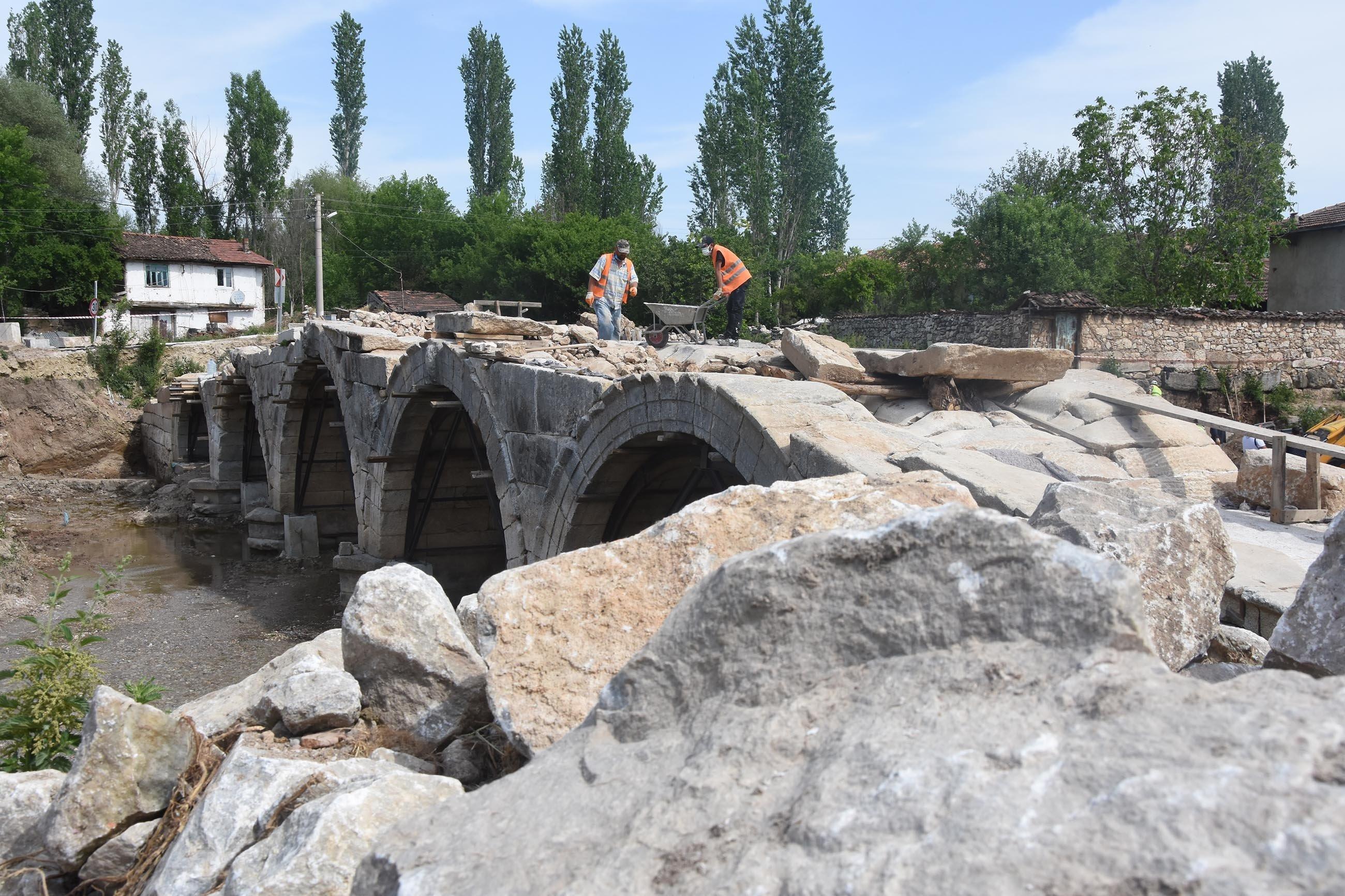 Specialists work on a historic Roman bridge that spans Kocaçay creek near the ancient city of Aizanoi in Kütahya, Turkey, May 30, 2021. (DHA Photo)