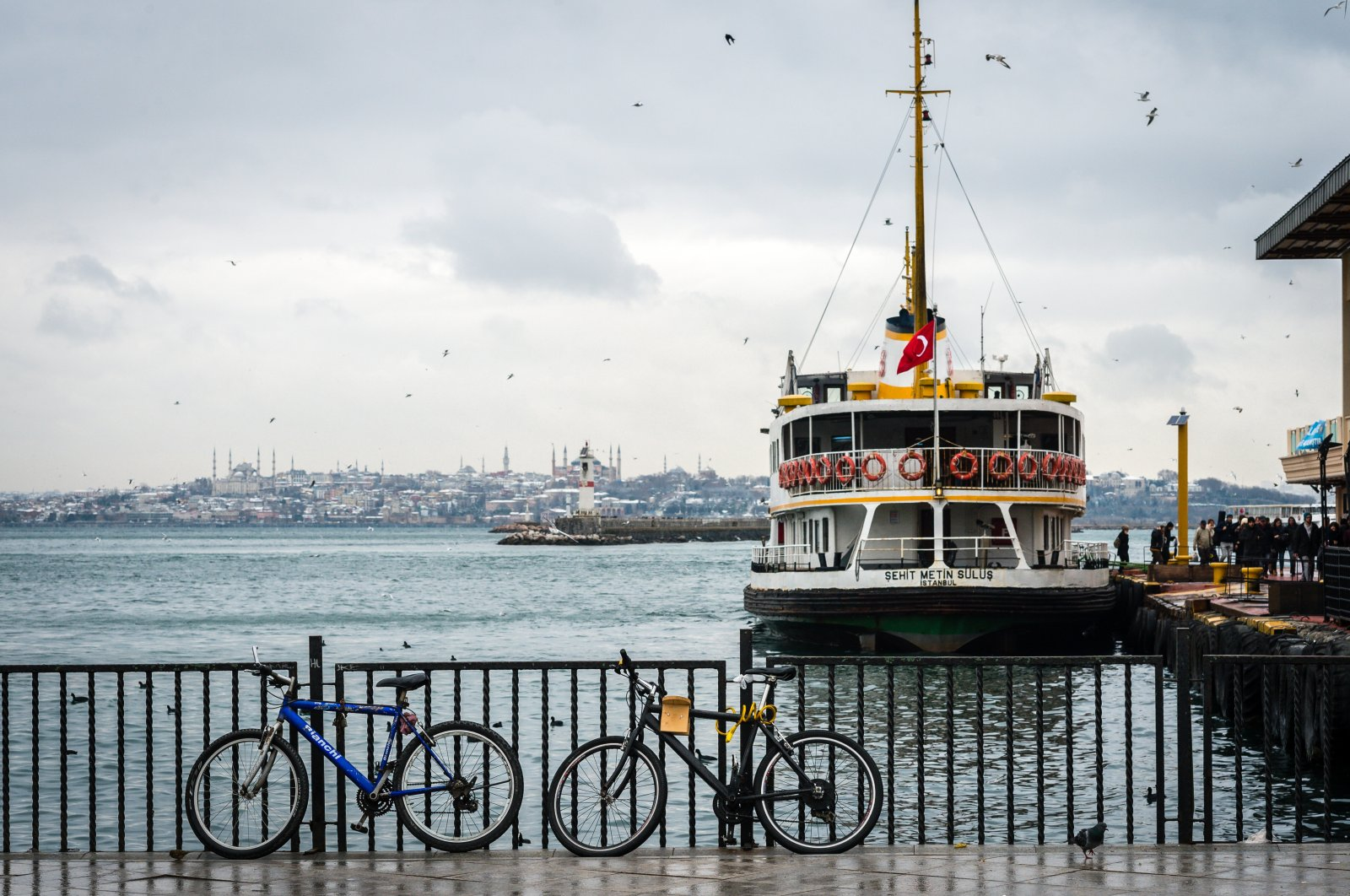 People getting off the ferry at the pier in Kadıköy, Istanbul, Turkey, Jan. 18, 2016. (Shutterstock Photo)