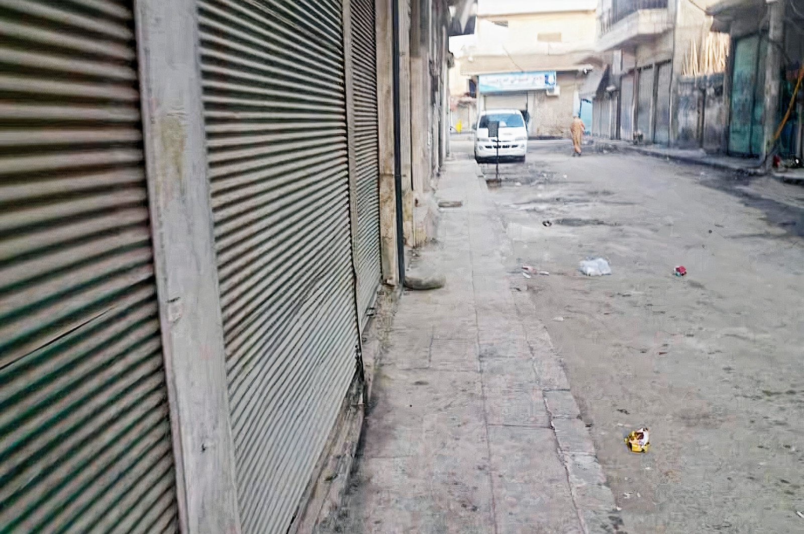 Closed shops are seen on a street in Syria's Manbij, May 31, 2021. (AA Photo)