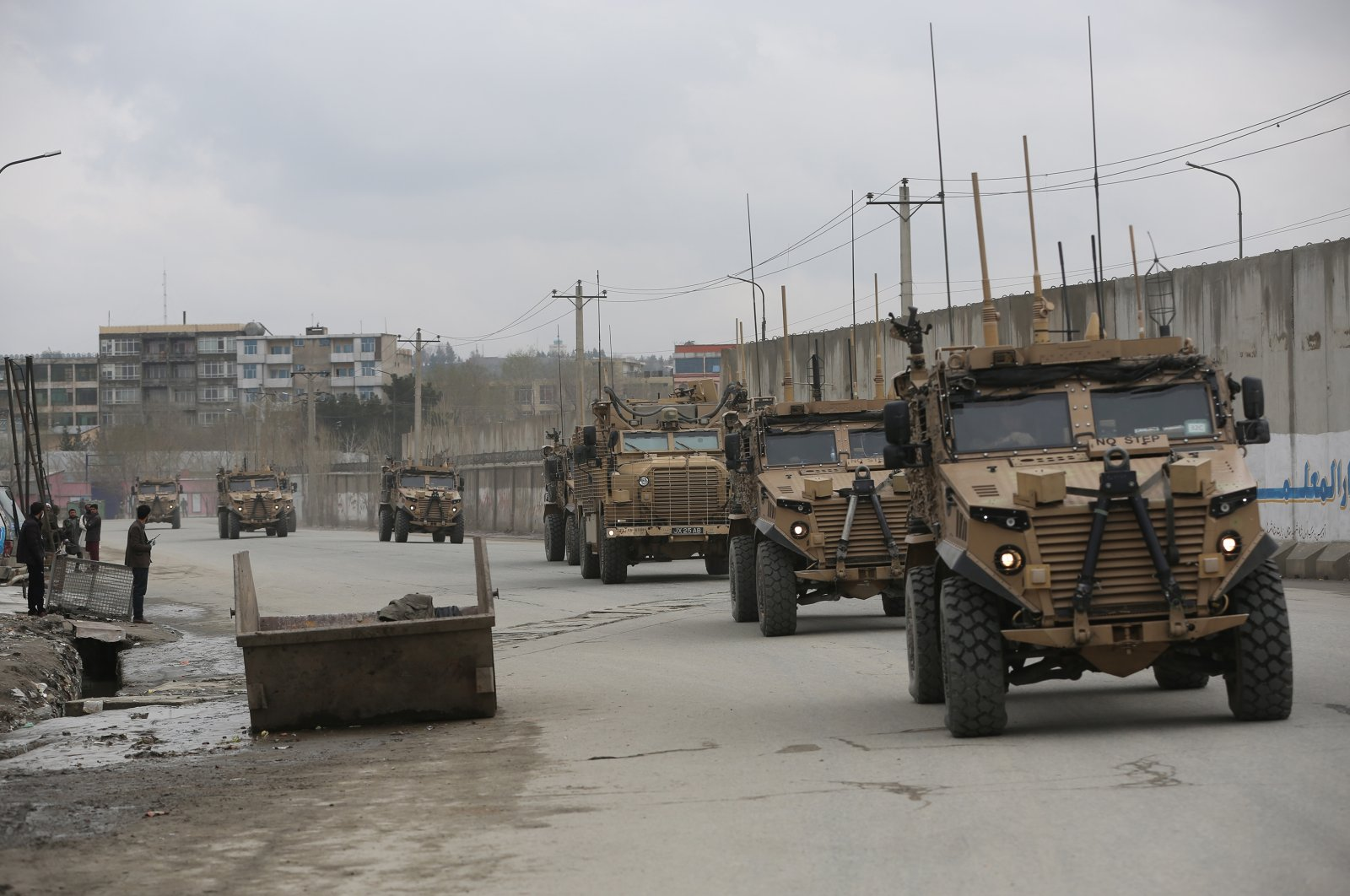 British troops with NATO-led Resolute Support Mission forces drive in Kabul, Afghanistan, March 25, 2020. (AP Photo)