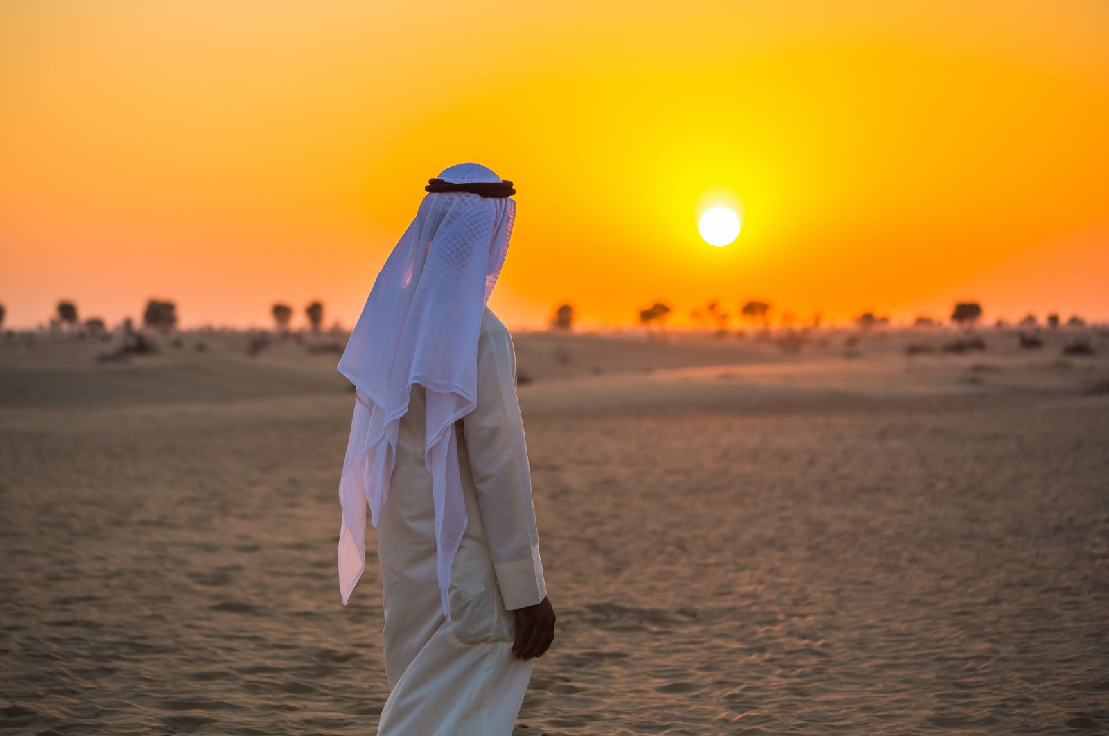 An illustration photo showing a man looking at the sunset in a desert in the Arab region. (Photo by Shutterstock)