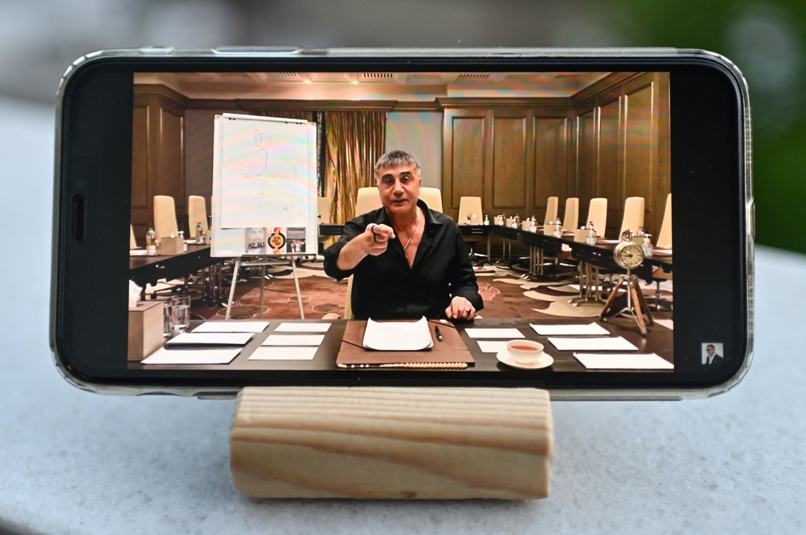 Sedat Peker talks in a video displayed on a mobile phone, in a photograph taken in Istanbul, Turkey, May 26, 2021. (AFP PHOTO)
