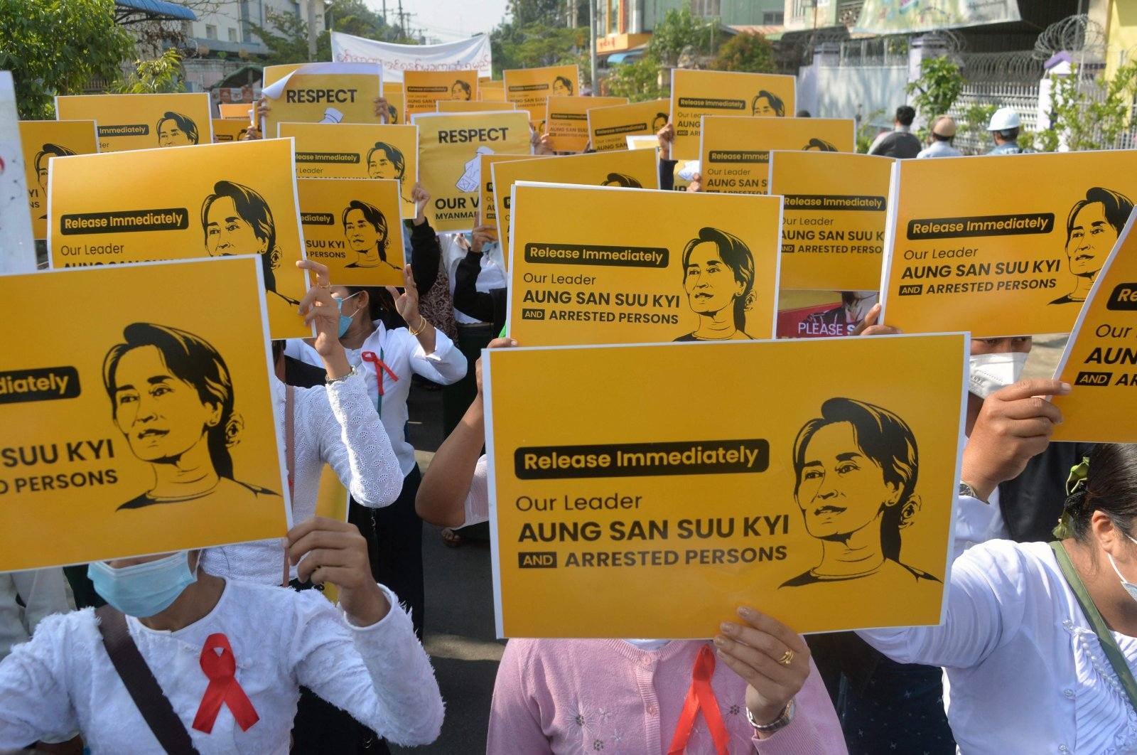 In this file photo, school teachers hold up signs during a demonstration against the military coup in Naypyidaw, Myanmar, photo taken on Feb. 17, 2021. (AFP Photo)