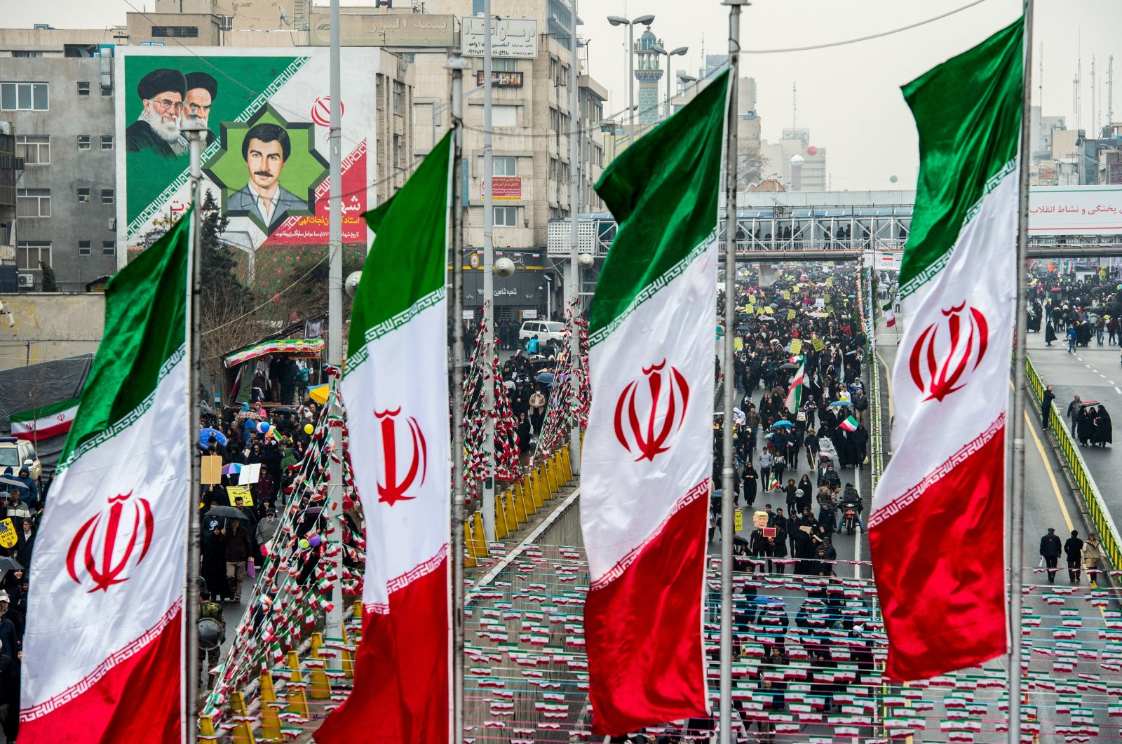 Demonstrators fill the street as Iranian national flag banners fly during the 40th anniversary of the Islamic revolution in Tehran, Iran, Feb. 11, 2019. (Photo by Getty Images)