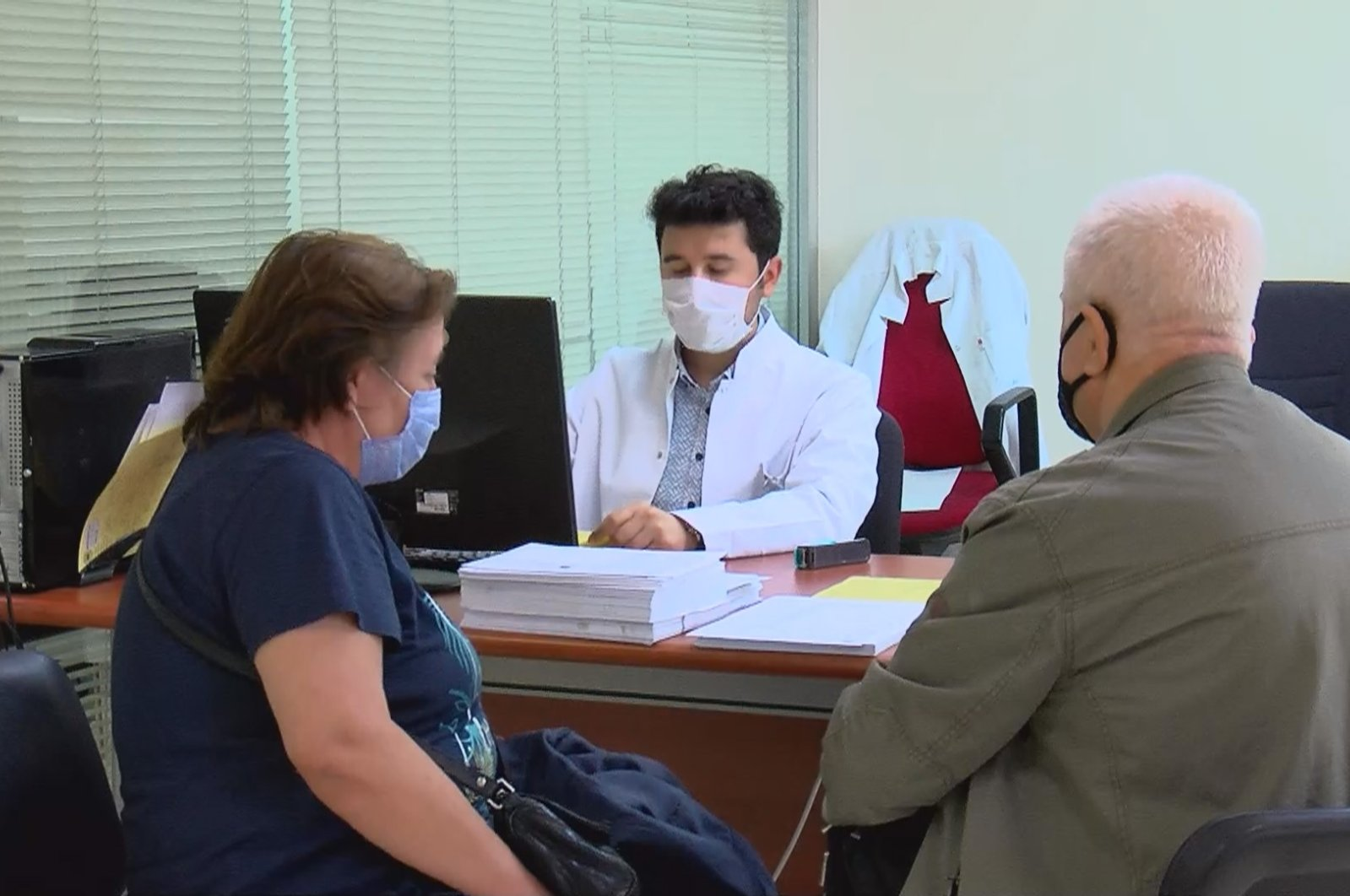 Recovered patients speak to a doctor at a COVID-19 monitoring center, in Istanbul, Turkey, June 1, 2021. (DHA PHOTO)