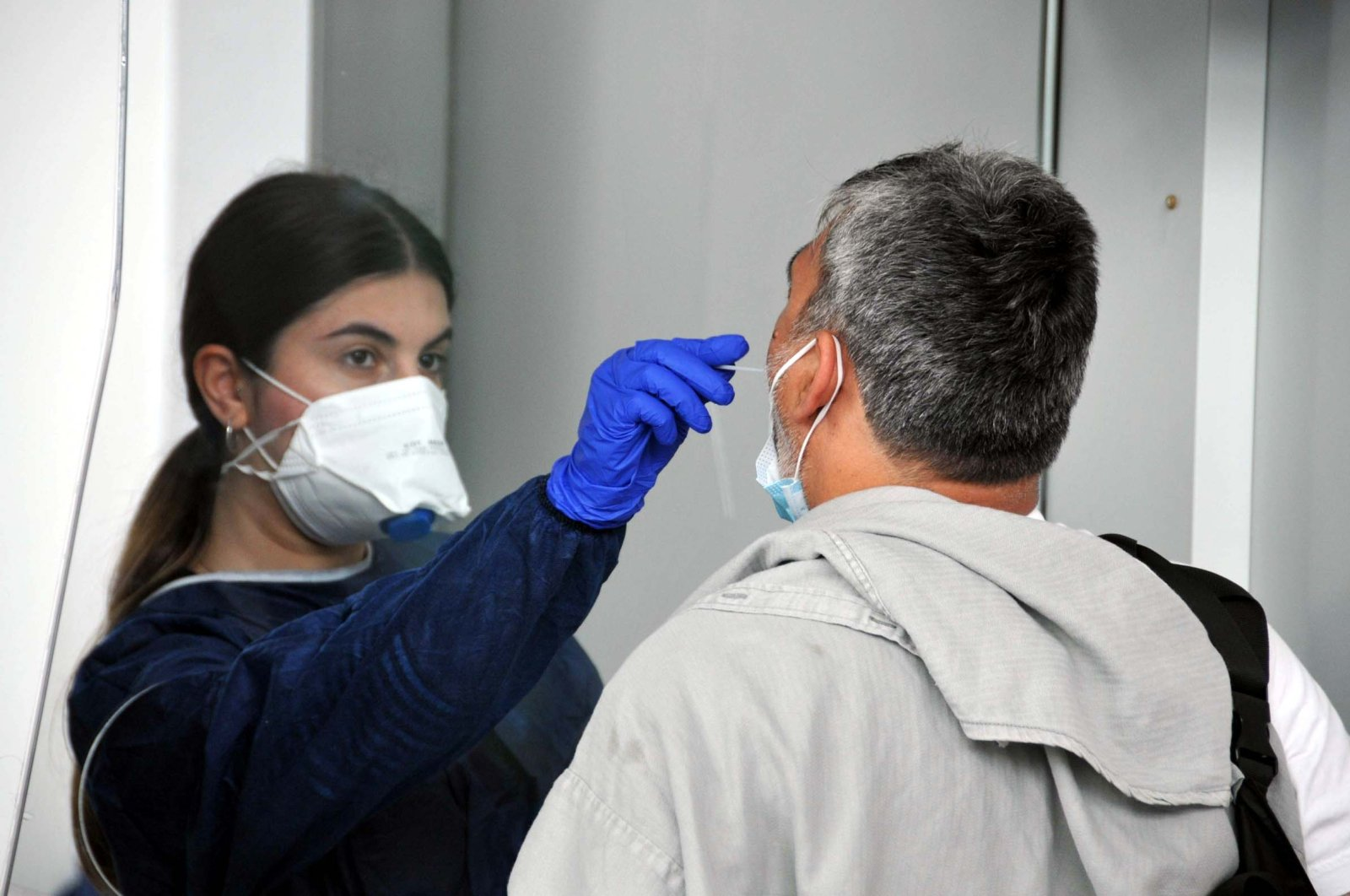 A passenger is tested for the coronavirus at Istanbul Airport, Istanbul, Turkey, June 1, 2021. (DHA PHOTO)