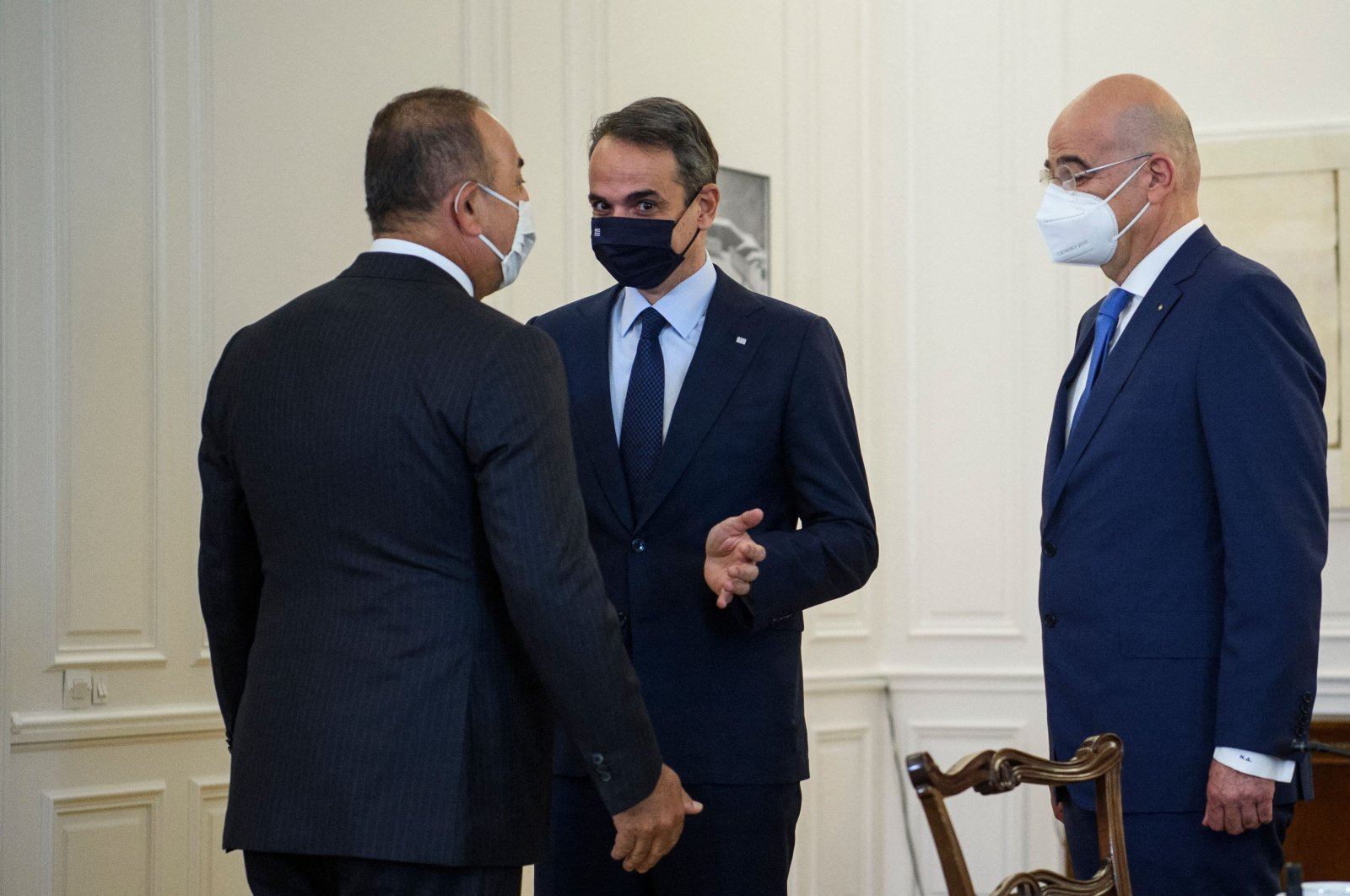 Foreign Minister Melvut Cavusoglu (L) speaks with Greek Prime Minister Kyriakos Mitsotakis (C) and Foreign Minister Nikos Dendias (R) before their meeting in Athens, Greece, May 31, 2021. (AFP Photo)