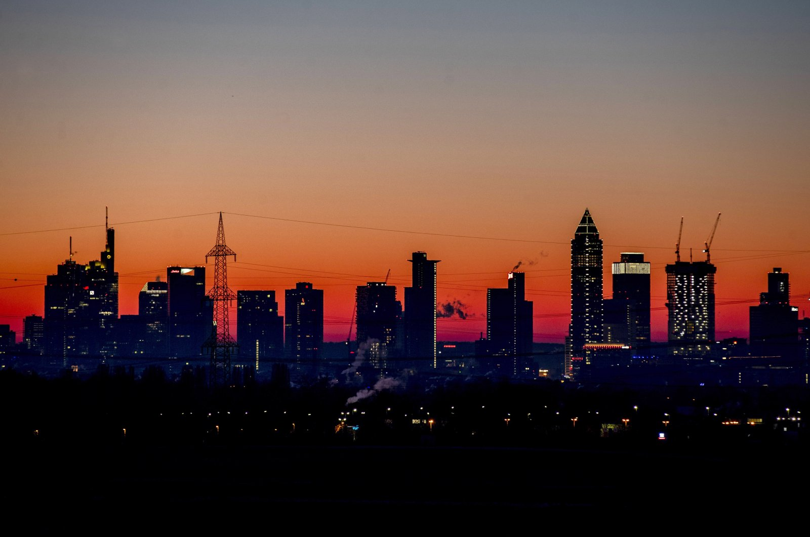 The sun is about to rise behind the buildings of the banking district in Frankfurt, Germany, Feb.14, 2021. (AP Photo)