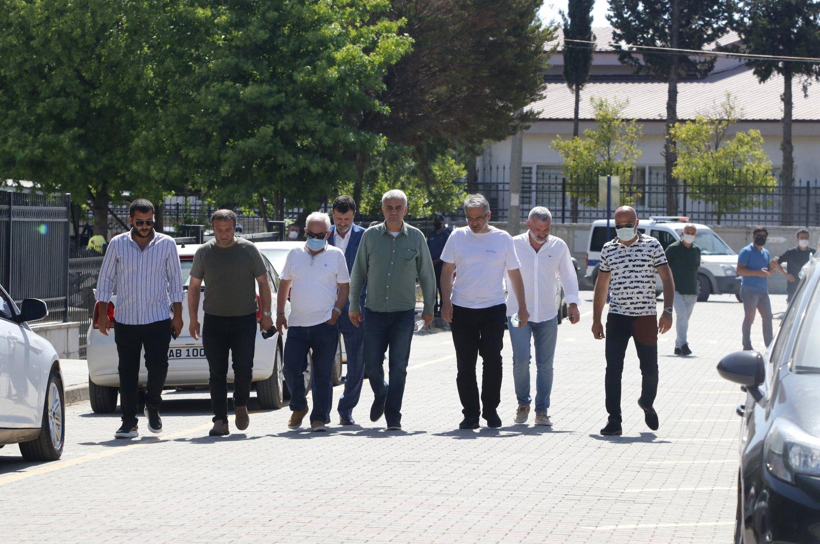 Atilla Peker (5th L) leaves the courthouse, in Muğla, southwestern Turkey, May 25, 2021. (AA PHOTO)