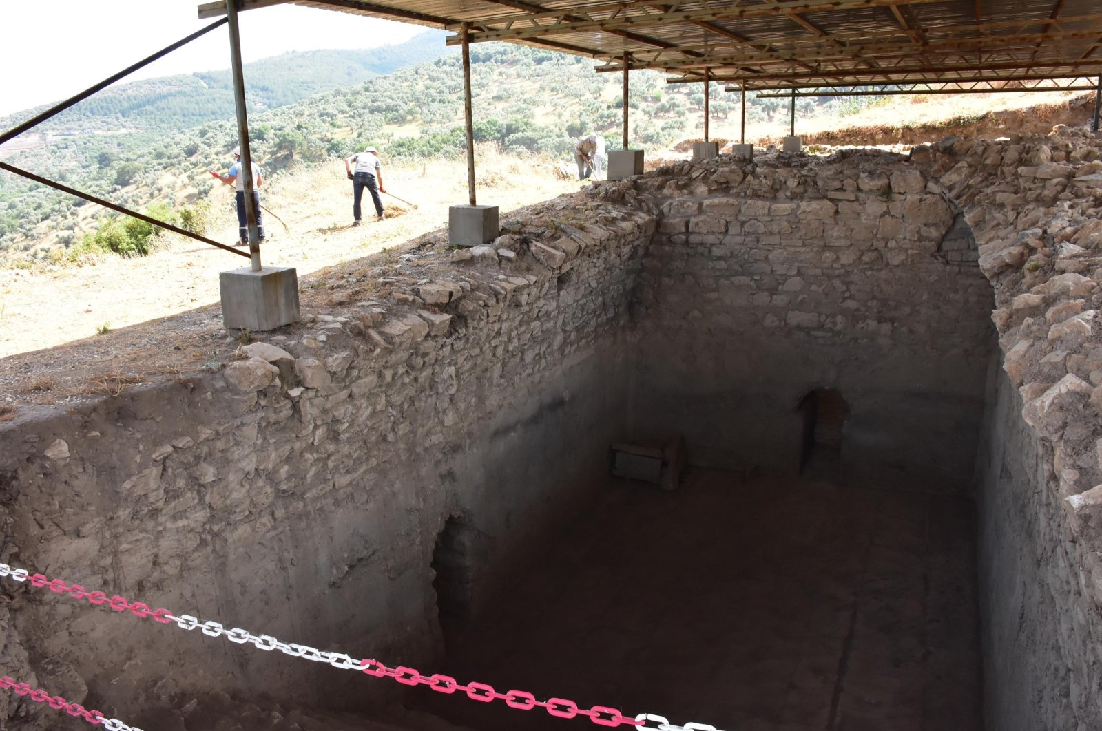 Specialists work around the excavation site of the cisterns at the classical city of Metropolis in Izmir, Turkey, May 30, 2021. (DHA Photo)