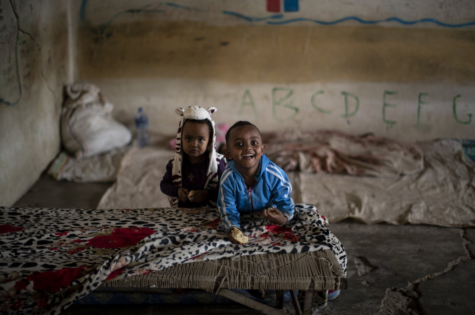 Young Tigrayan children play in a classroom where they now live at a camp for the internally displaced in an elementary school in Mekele, in the Tigray region of northern Ethiopia, May 10, 2021. (AP Photo)