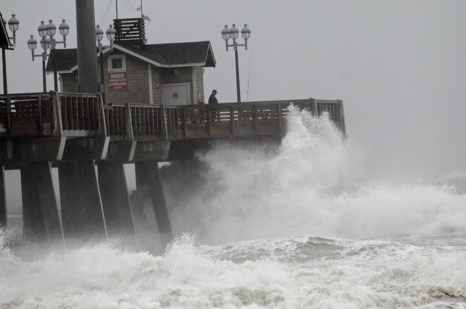 Large waves generated by Hurricane Sandy crash into Jeanette's Pier in Nags Head as the storm moves up the east coast, N.C., U.S., Oct. 27, 2012. (AP Photo)