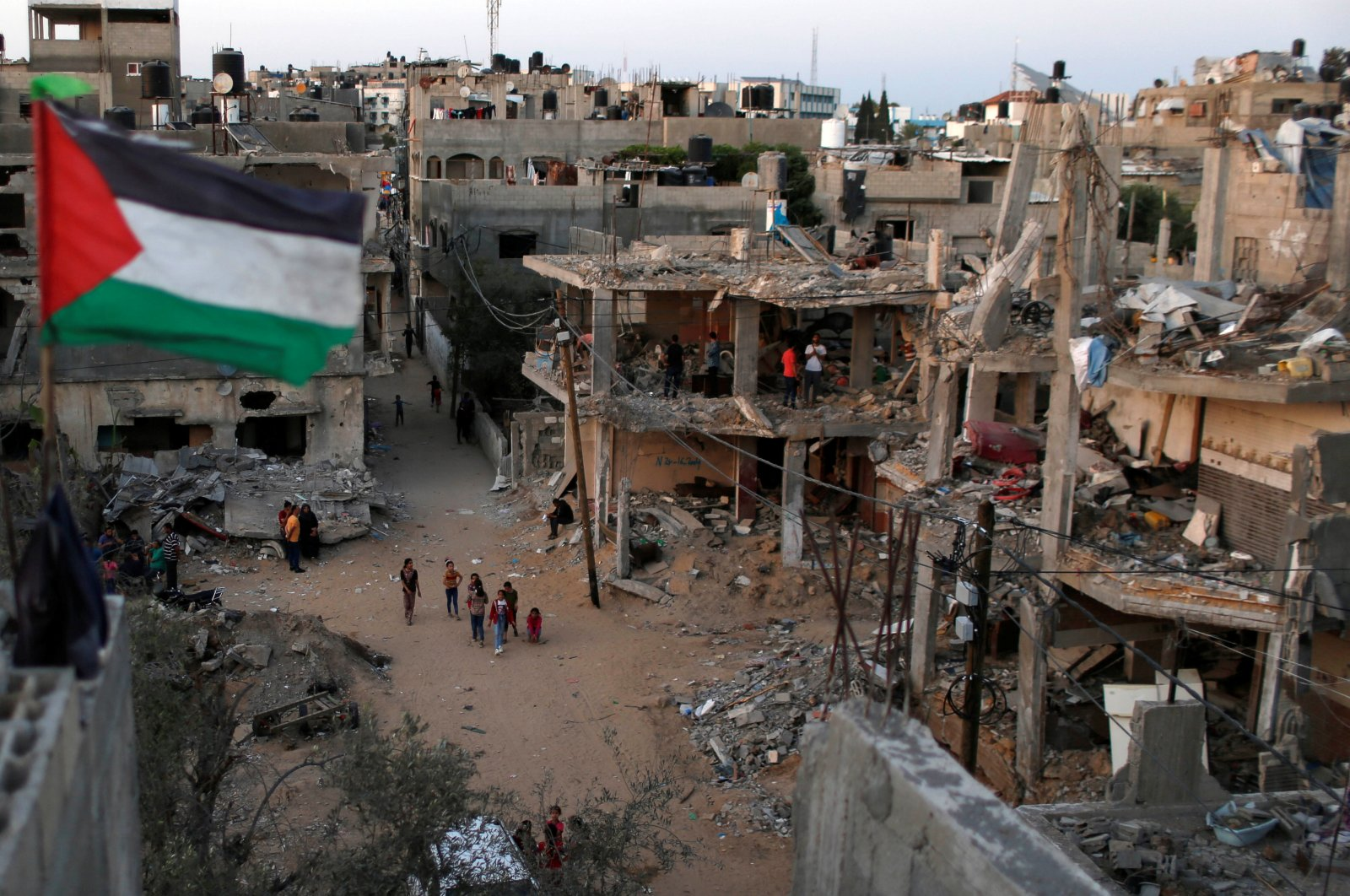 A Palestinian flag flies amid the ruins of houses destroyed by Israeli airstrikes, the Gaza Strip, Palestine, May 25, 2021. (Reuters Photo)