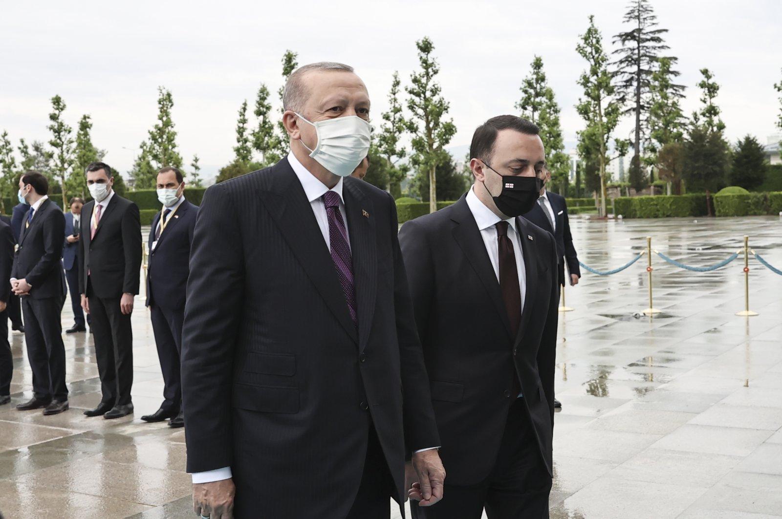 President Recep Tayyip Erdoğan (L) and Georgian Prime Minister Irakli Garibashvili walk towards the entrance at the Presidential Complex, Ankara, Turkey, June 1, 2021. (AA Photo)