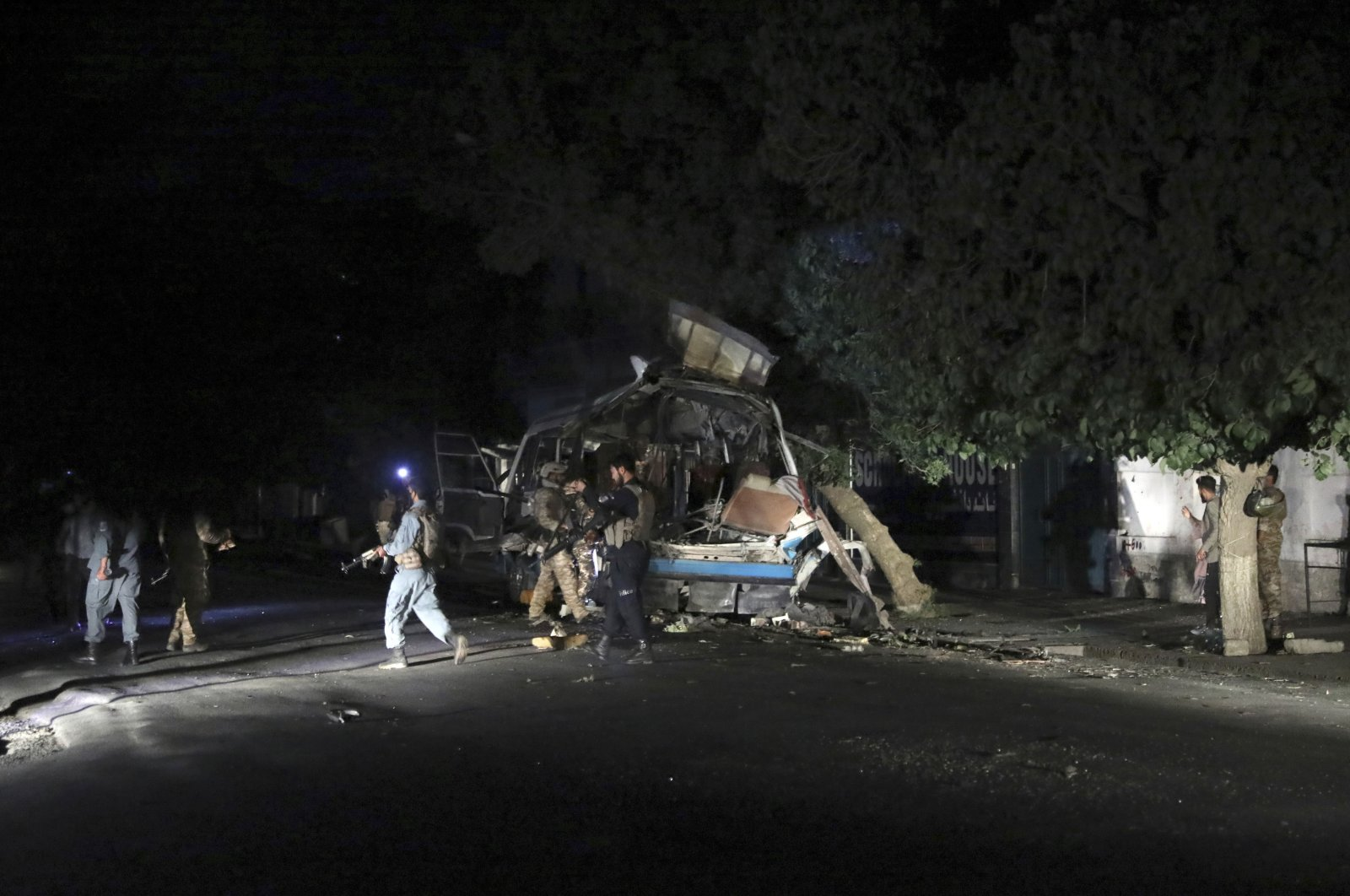 Afghan security personnel inspect the site of a bomb explosion in Kabul, Afghanistan, June 1, 2021. (AP Photo)