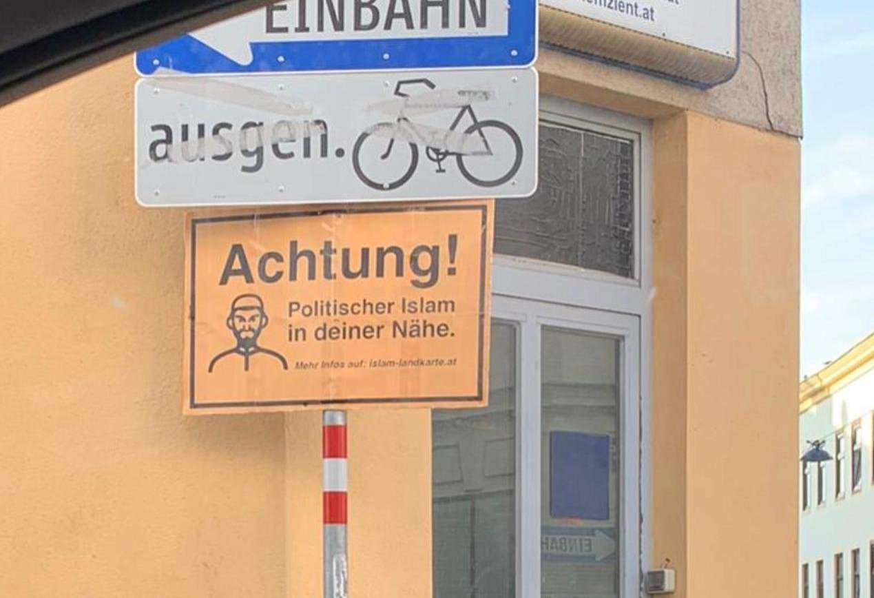 """This undated picture shows a sign with the words """"Beware! Political Islam nearby"""" and an image of a man with a beard and skullcap, these signs can be seen hanging outside many mosques in Vienna, Austria. (AA Photo)"""