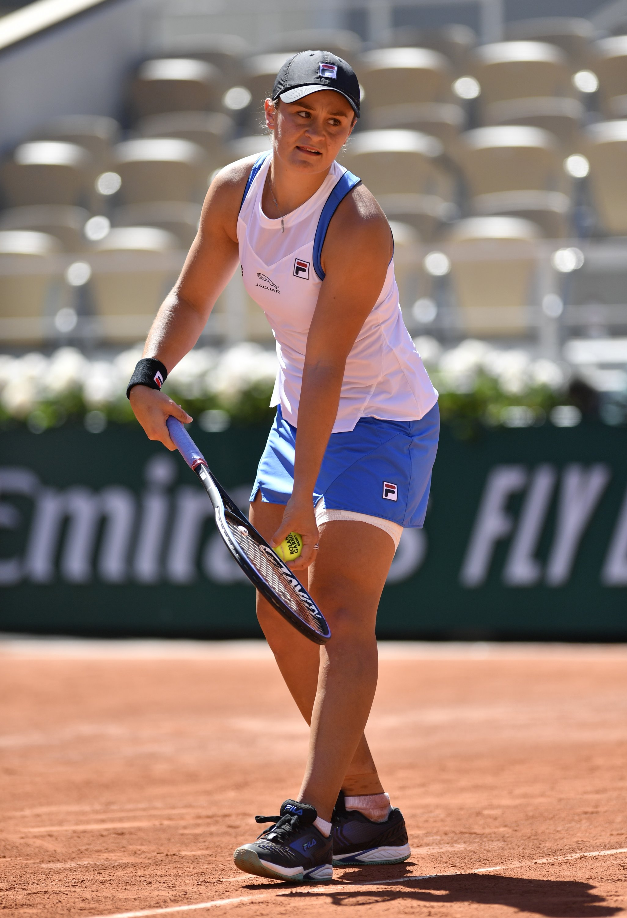 Australia's Ashleigh Barty serves against Bernarda Pera in their French Open first-round match, Paris, France, June 1, 2021. (AA Photo)