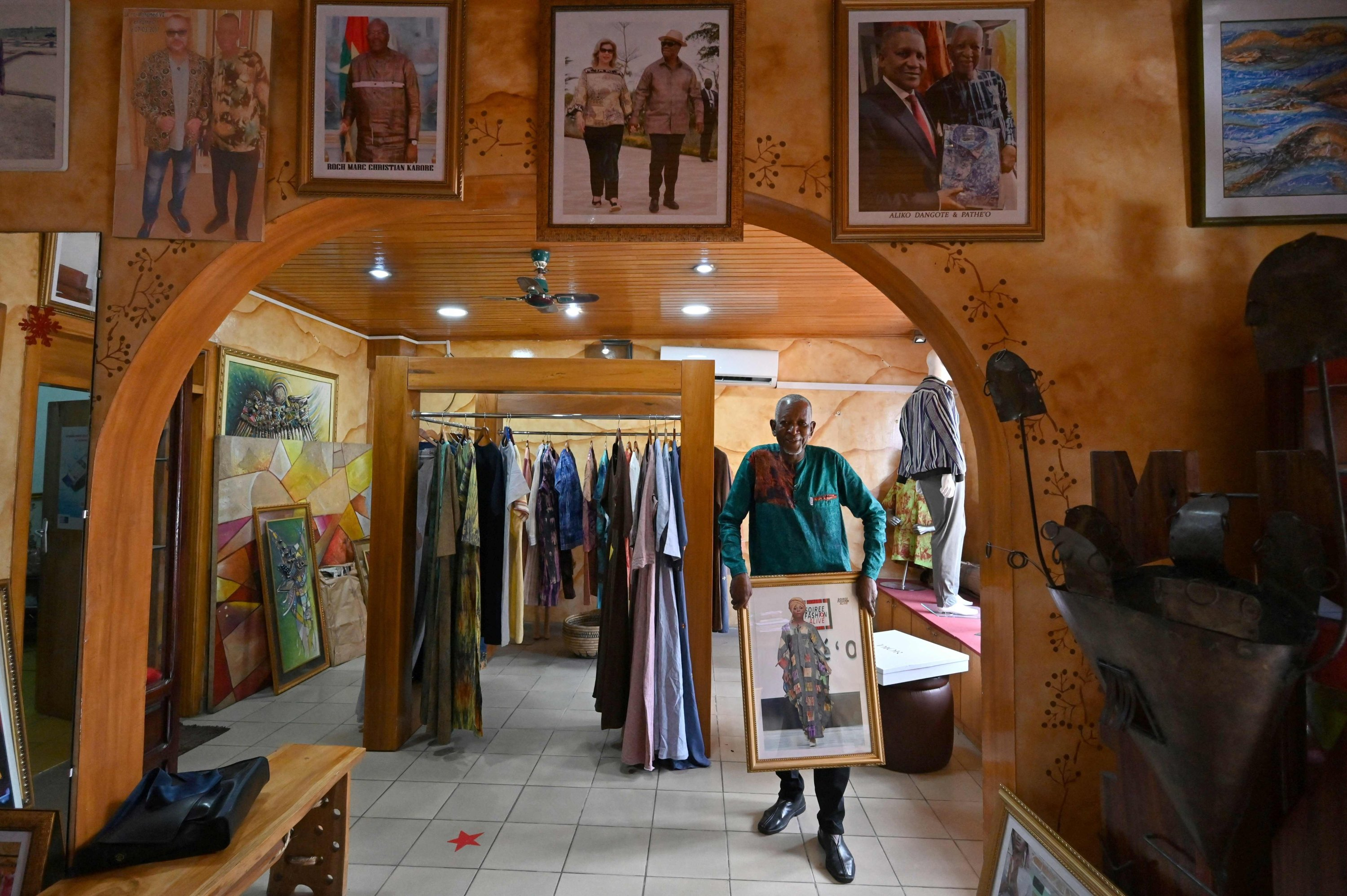 Ivorion-Burkinabe fashion designer Pathe Ouedraogo, known as Pathe'O, poses for a photograph in his store in Abidjan, Ivory Coast, May 26, 2021. (AFP Photo)