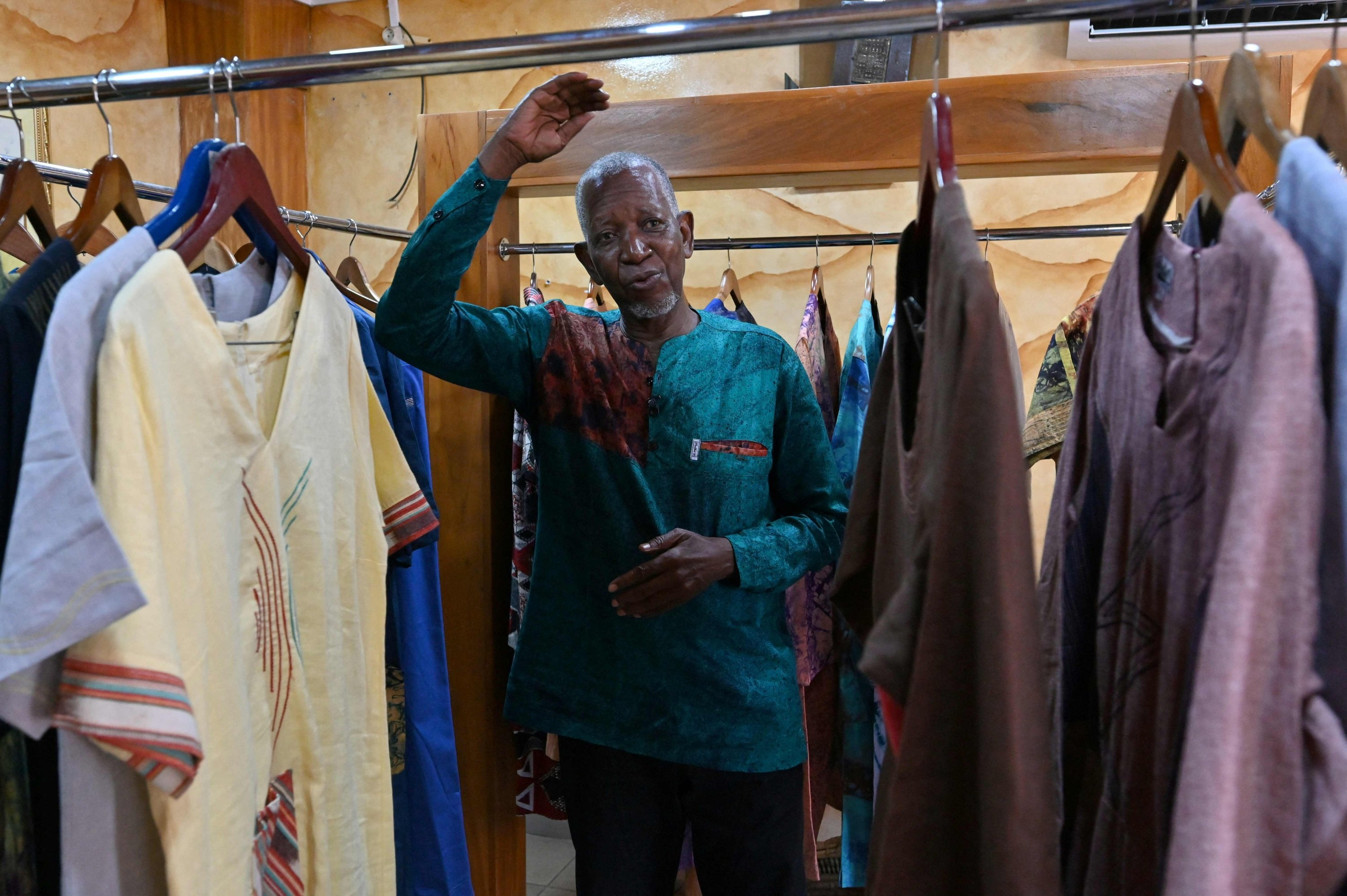 Fashion desiner Pathe Ouedraogo known as Pathé'O pose in his store in Abidjan, Ivory Coast, May 26, 2021. (AFP Photo)