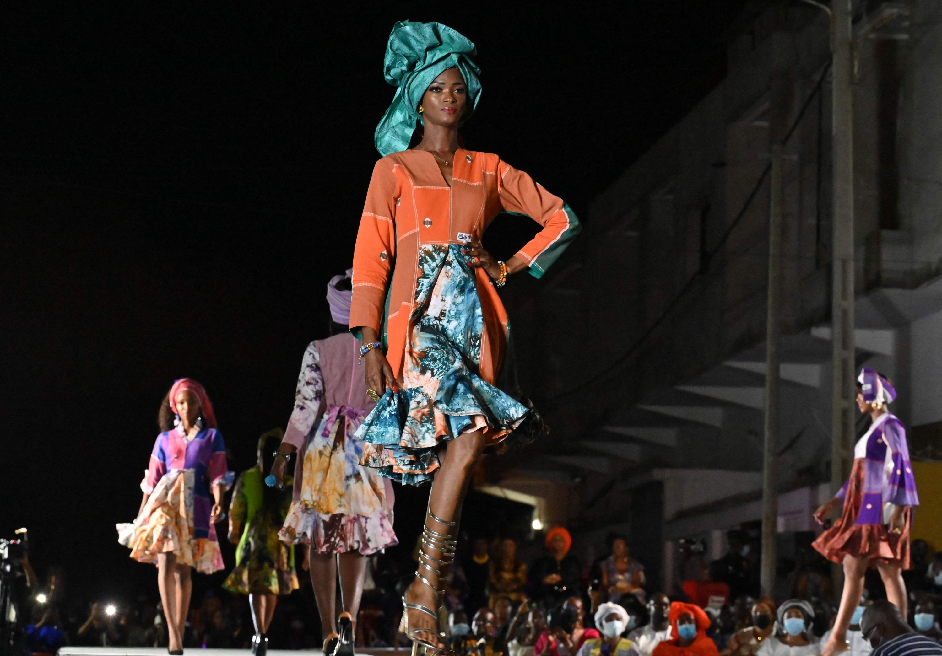 Models present the creations of Pathé'O during a fashion show to celebrate 50 years of 'Maison Pathe'O' in Abidjan, Ivory Coast, May 29, 2021. (AFP Photo)