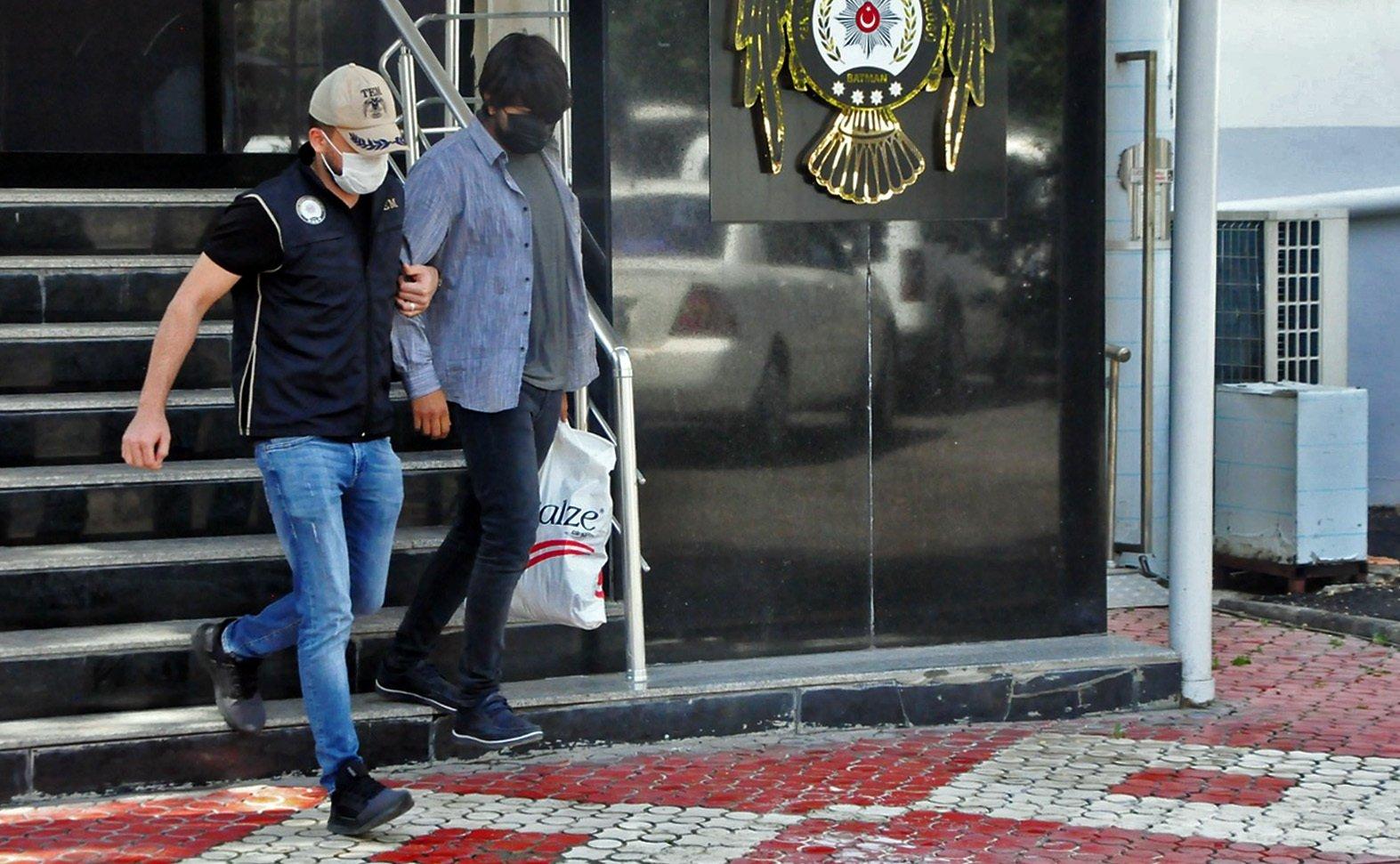 Police escort captured FETÖ suspects, in Batman, eastern Turkey, June 1, 2021. (İHA PHOTO)