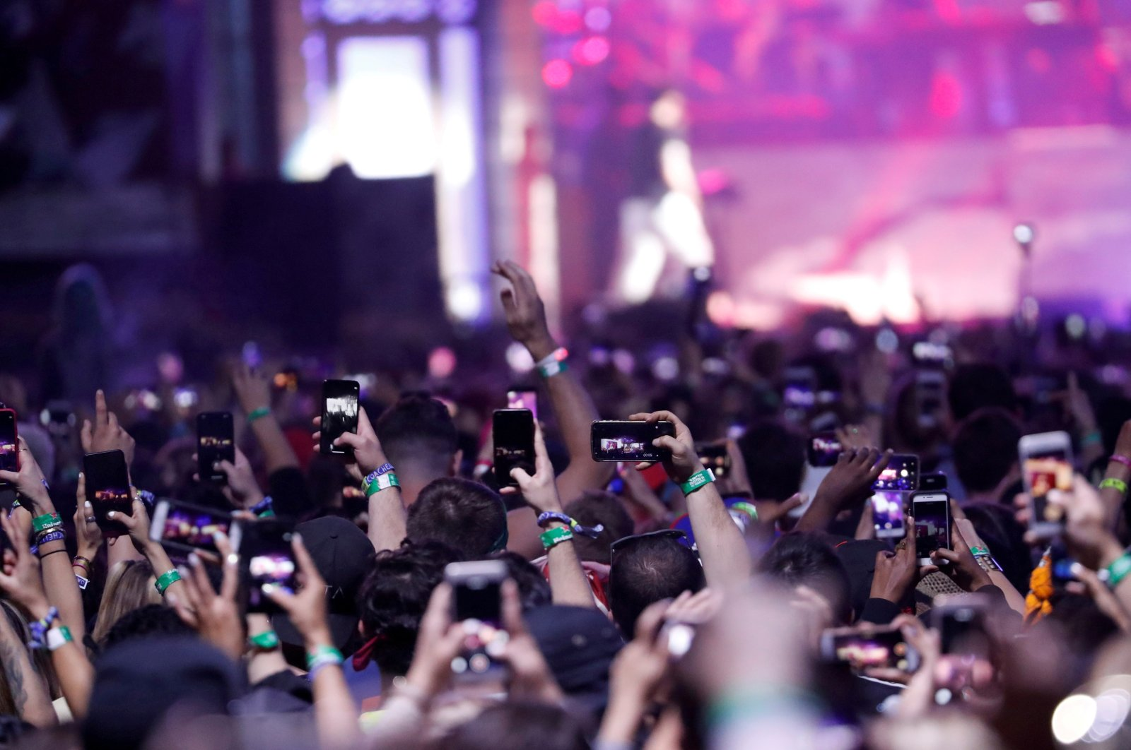 Concertgoers use their mobile phones during Eminem's performance at the Coachella Valley Music and Arts Festival in Indio, California, U.S., April 15, 2018. (REUTERS Photo)