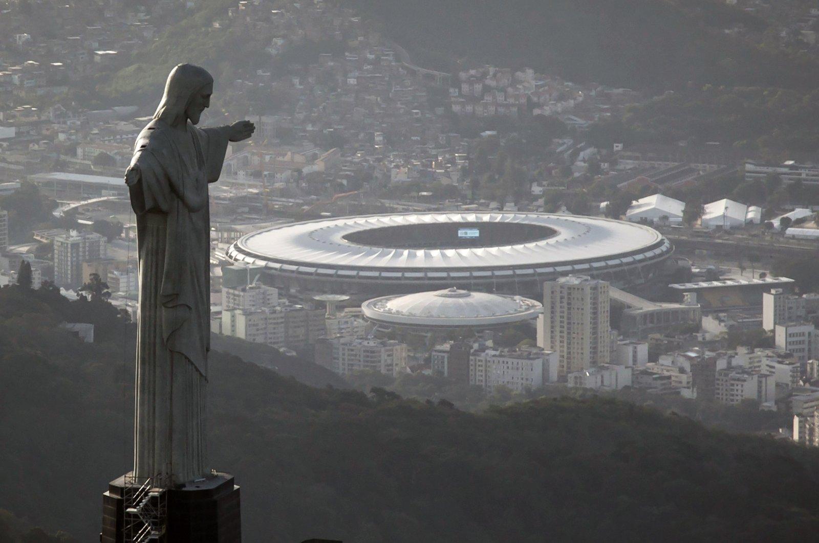 The Maracana stadium behind the Christ the Redeemer statue in Rio de Janeiro, Brazil, May 13, 2014. (AP Photo)