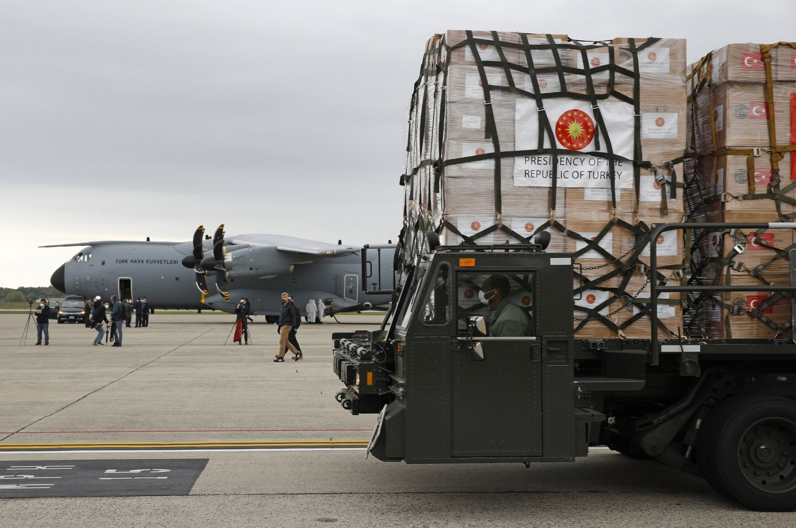 A U.S. Air Force vehicle carries a donation of medical supplies from Turkey after it was unloaded from a military plane, April 28, 2020. (AP Photo)