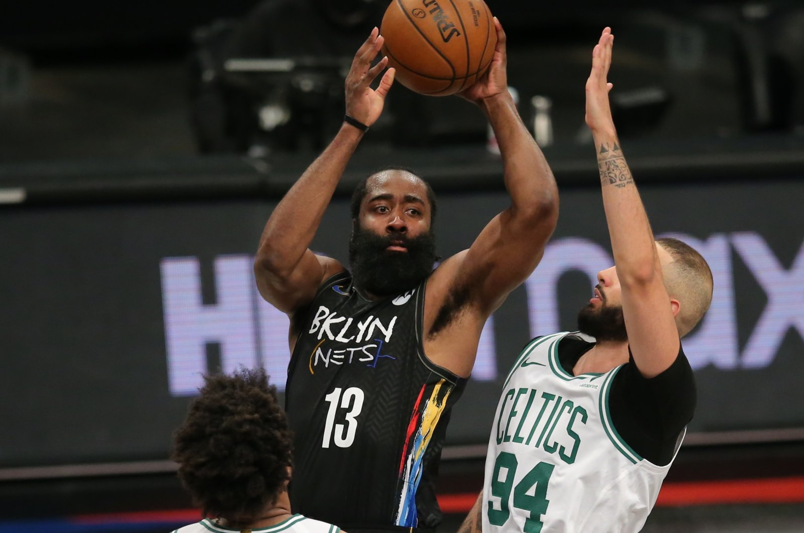Brooklyn Nets shooting guard James Harden (C) looks to pass against Boston Celtics point guard Marcus Smart (L) and shooting guard Evan Fournier (R) during their 2021 NBA Playoffs at Barclays Center, Jun 1, 2021, Brooklyn, New York, U.S. (Reuters Photo)