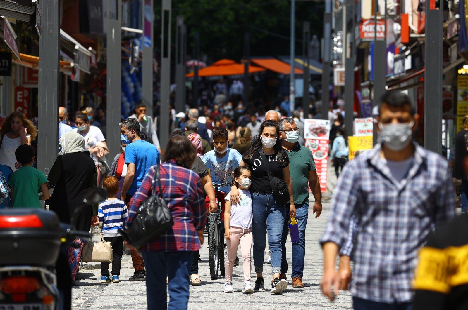 People wearing protective masks walk on a street in Edirne, northwestern Turkey, June 1, 2021. (AA Photo)
