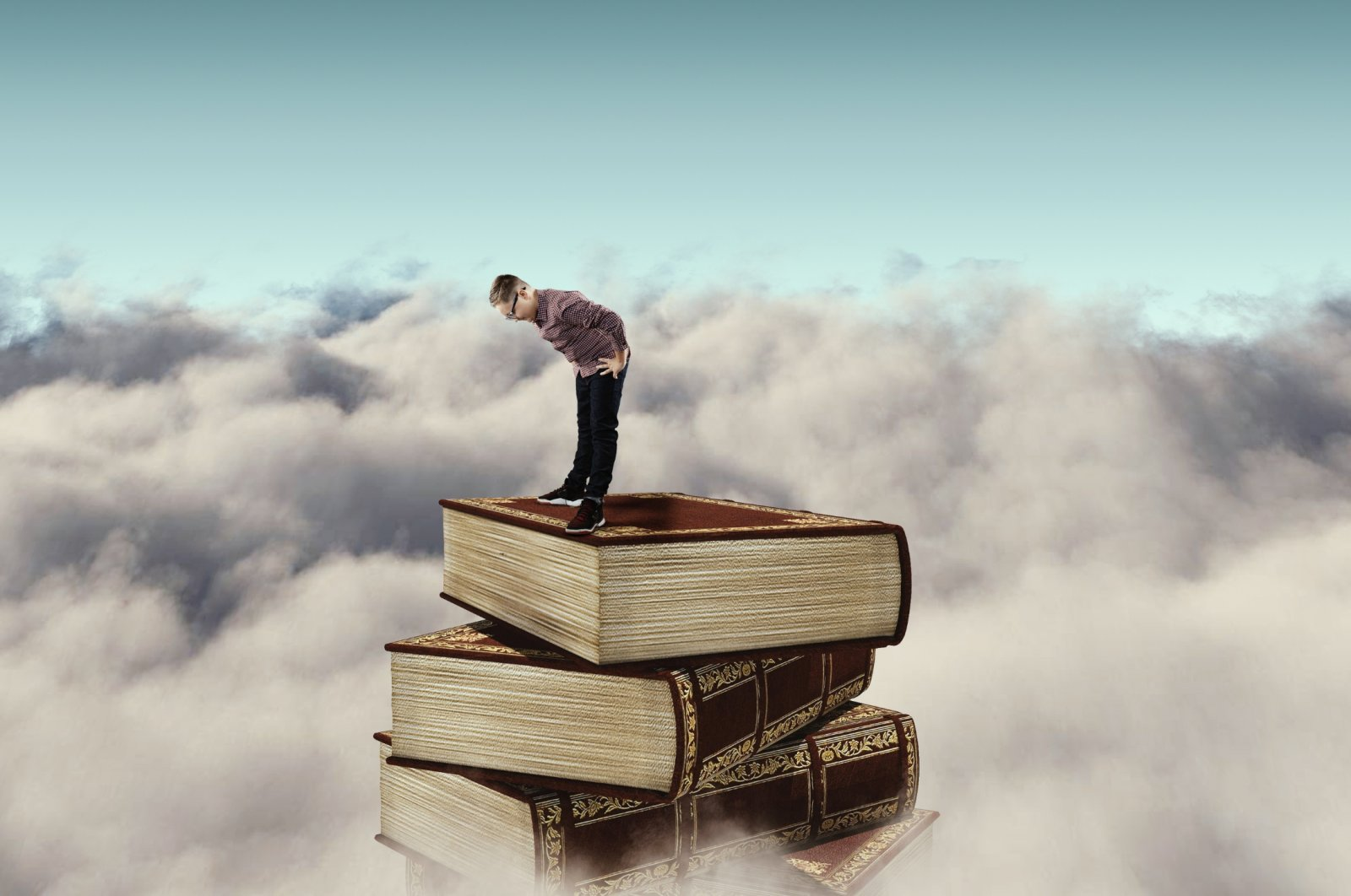A digital illustration shows a child standing on a stack of books above the clouds. (Shutterstock Photo)