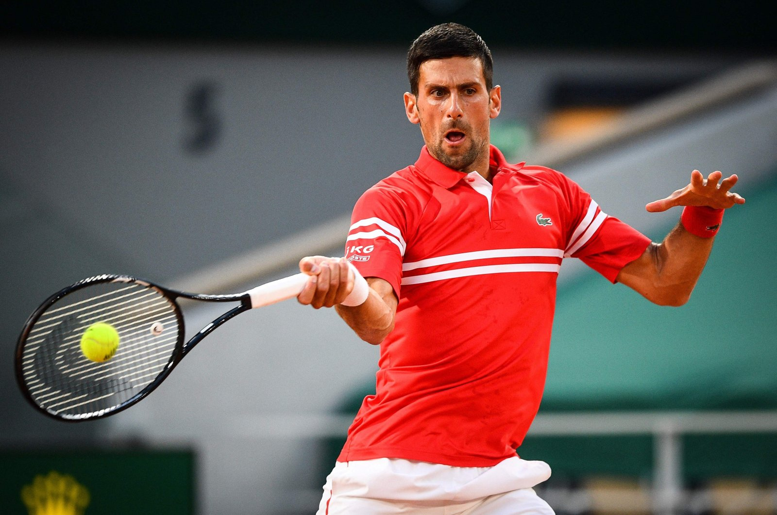 Serbia's Novak Djokovic returns the ball to Tennys Sandgren of the US during their French Open men's singles first-round match at the Roland Garros, Paris, France, June 1, 2021. (AFP Photo)
