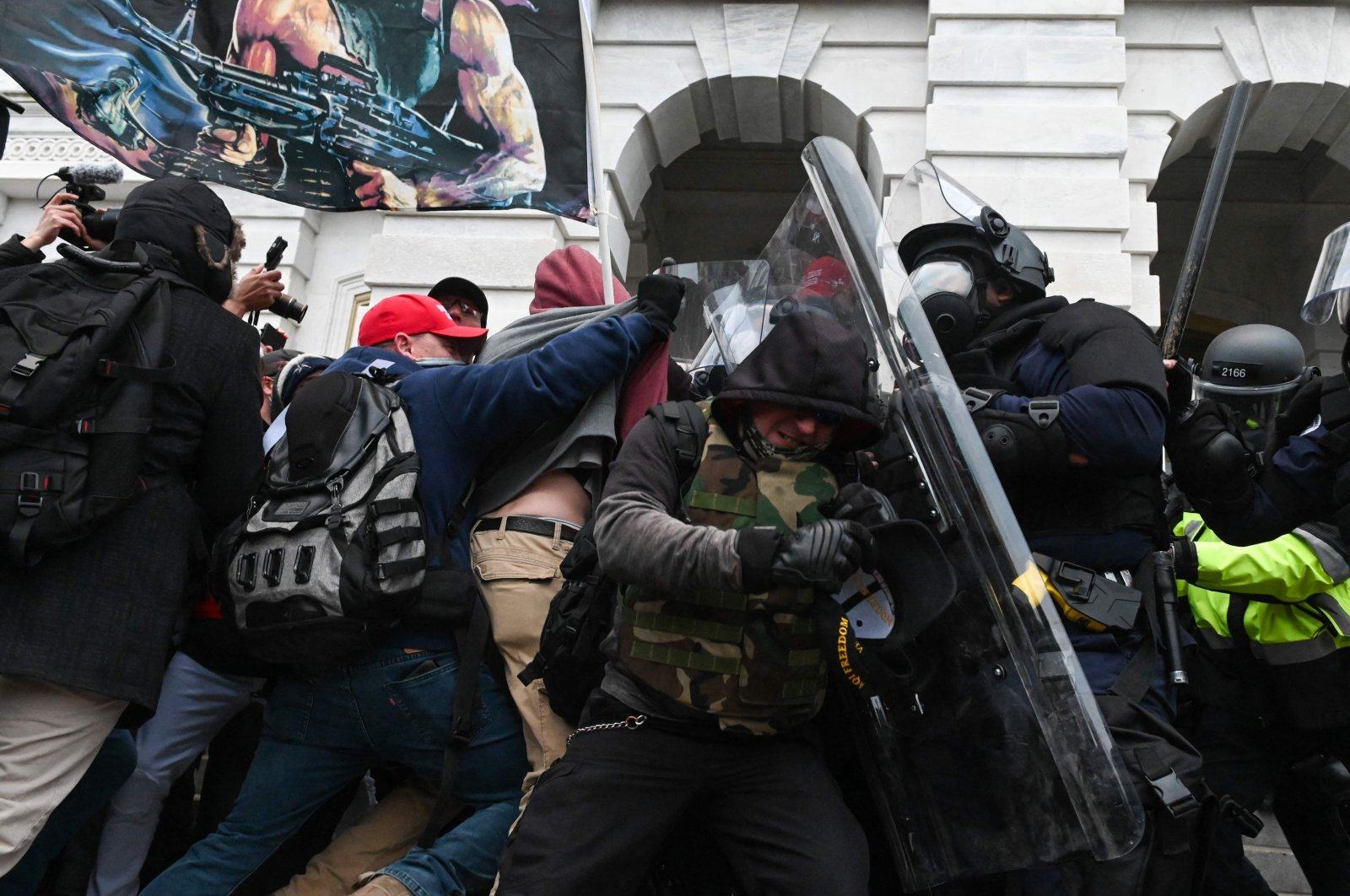Police push back a crowd of supporters of U.S. President Donald Trump after they stormed the Capitol building in Washington, D.C., U.S., Jan. 6, 2021. (AFP Photo)