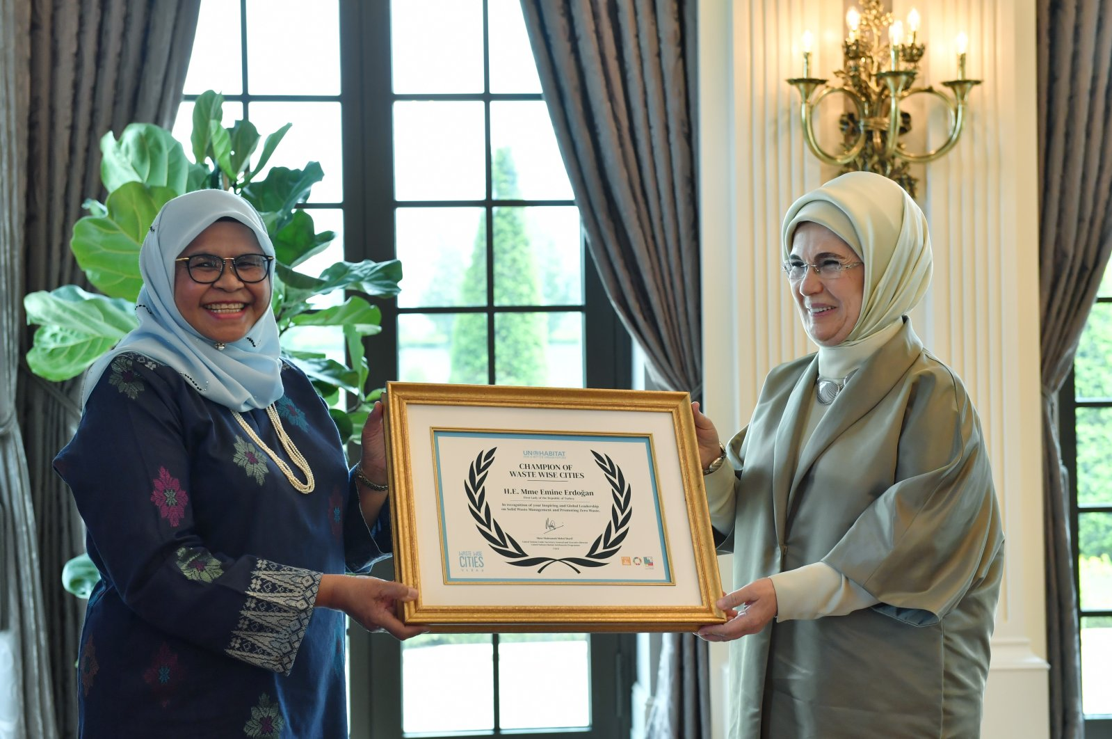 Executive Director of UN-Habitat Maimunah Mohd Sharif (L) presents First Lady Emine Erdoğan her award during a ceremony in the capital Ankara, Turkey, June 2, 2021. (AA Photo)