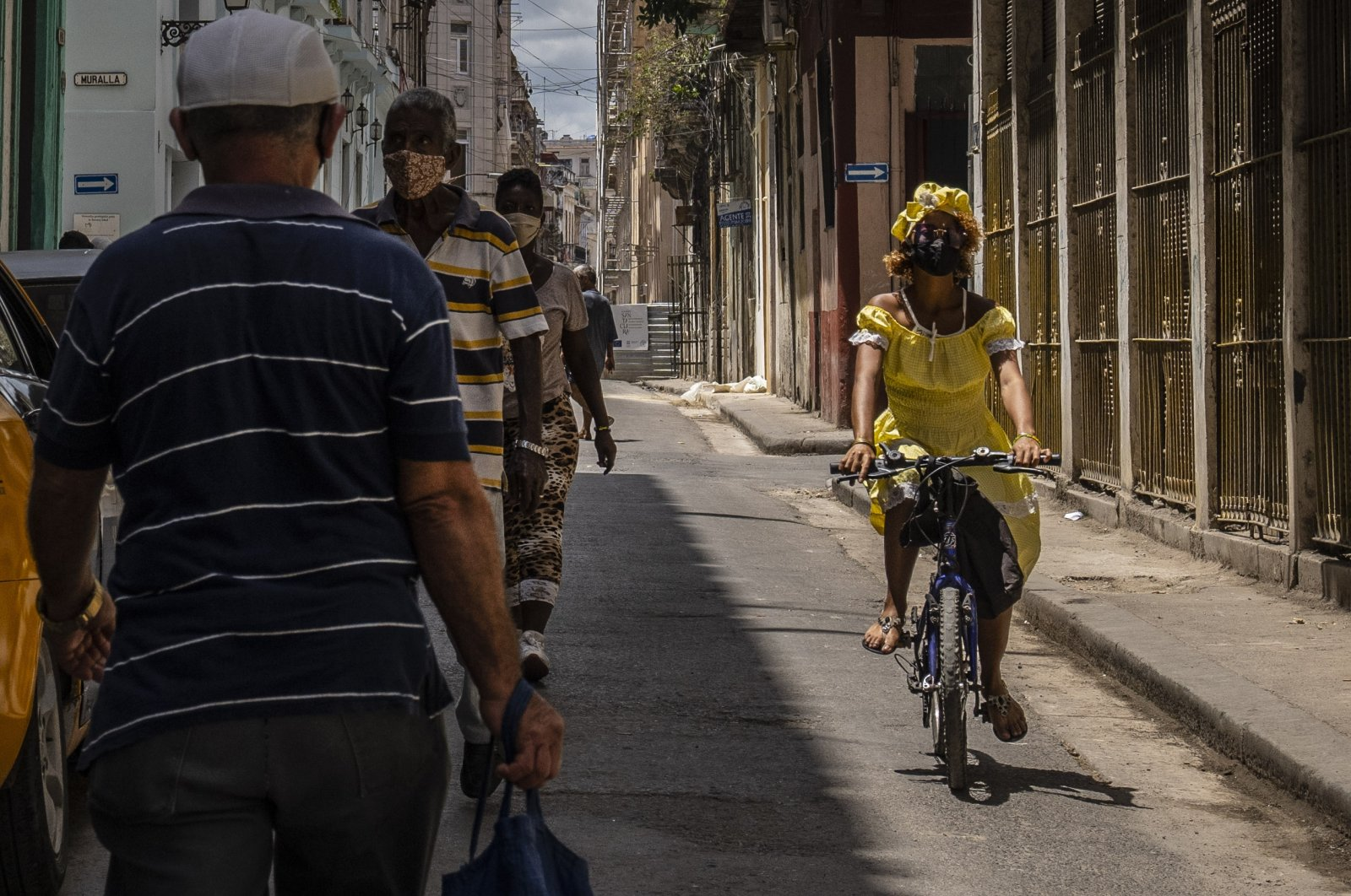 A woman rides her bicycle along a street in Havana, Cuba, Wednesday, June 2, 2021. (AP Photo / Ramon Espinosa)