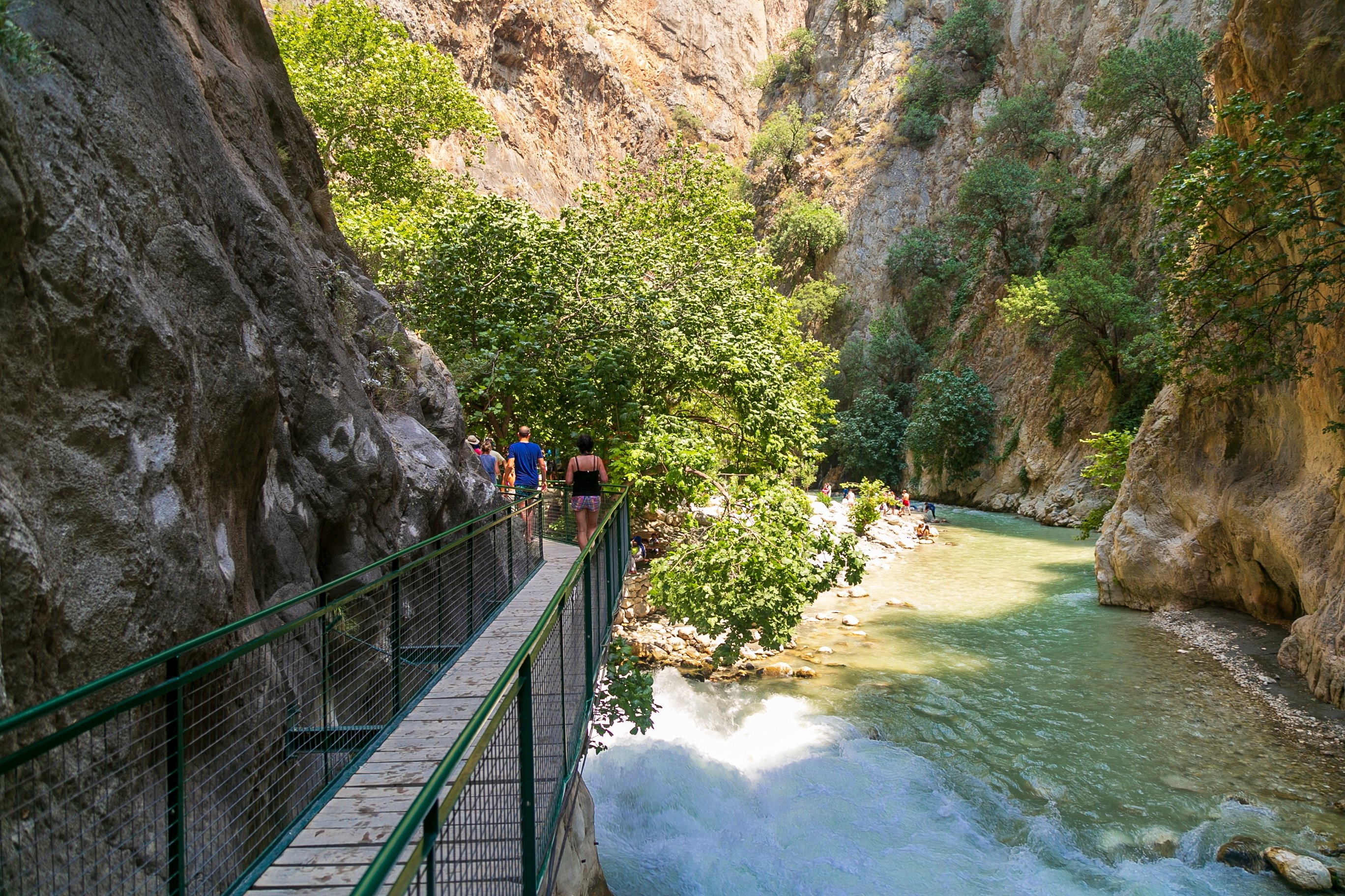 Tourists walk in Saklikent Canyon in southern Turkey. (Shutterstock Photo)
