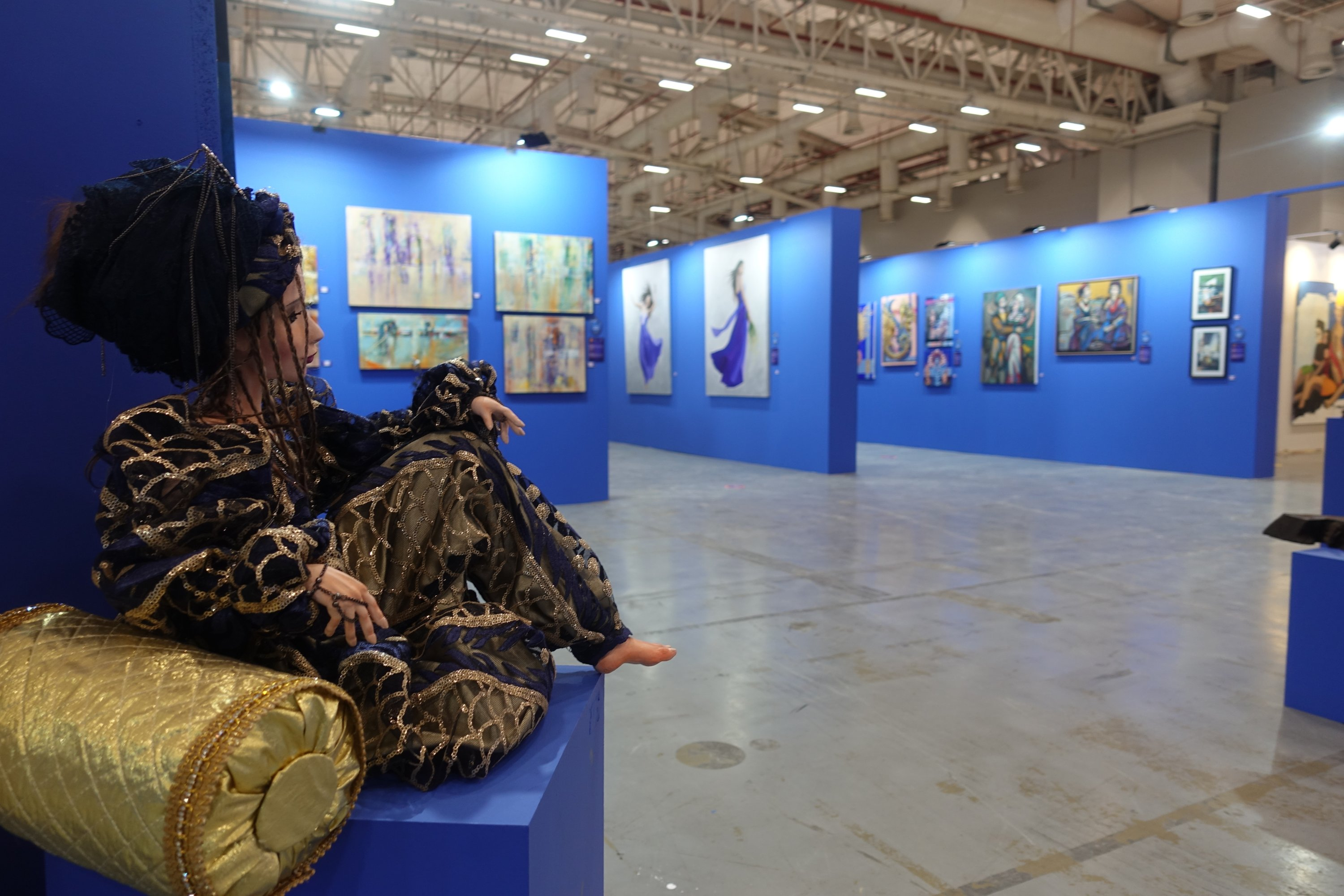 An extragavantly dressed mannequin sits and watches over the fairatthe ArtContact Istanbul Art Fair, Istanbul, Turkey, May 31, 2021. (AA Photo)