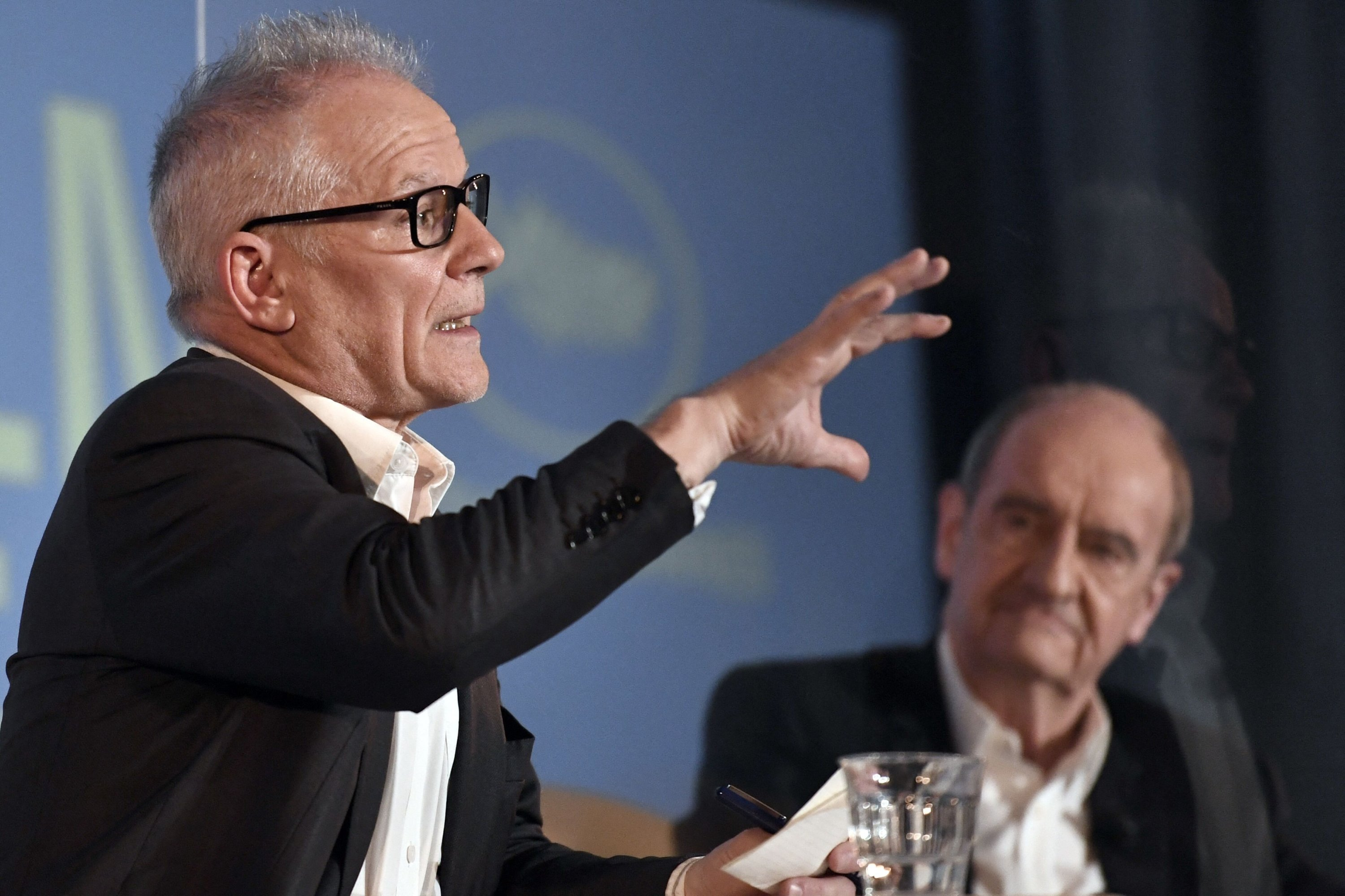 Cannes film festival general delegate Thierry Fremaux (L) gestures while speaking at a press conference to announce the official selection of films of the 74th Cannes Film Festival with French director of the festival Pierre Lescure listening in the background, Paris, France, June 3, 2021. (AFP Photo)