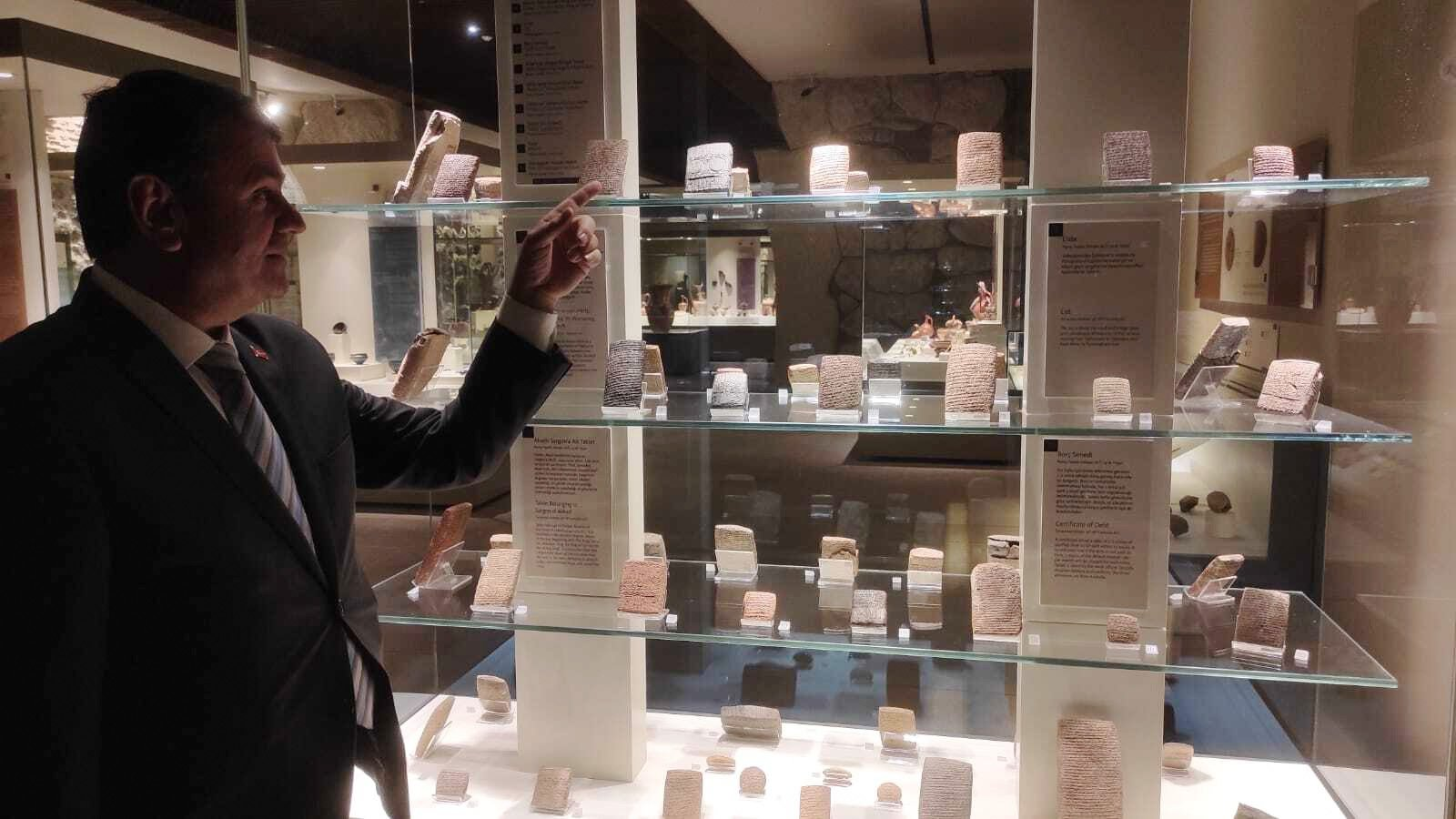 """Museum Director Yusuf Kıraç shows some ancient clay tablets about the epidemics on Anatolian lands from the """"Konuşan Tabletler"""" (""""Speaking Tablets"""") exhibition at the Museum of Anatolian Civilizations, Ankara, Turkey, June 2, 2021. (AA Photo)"""
