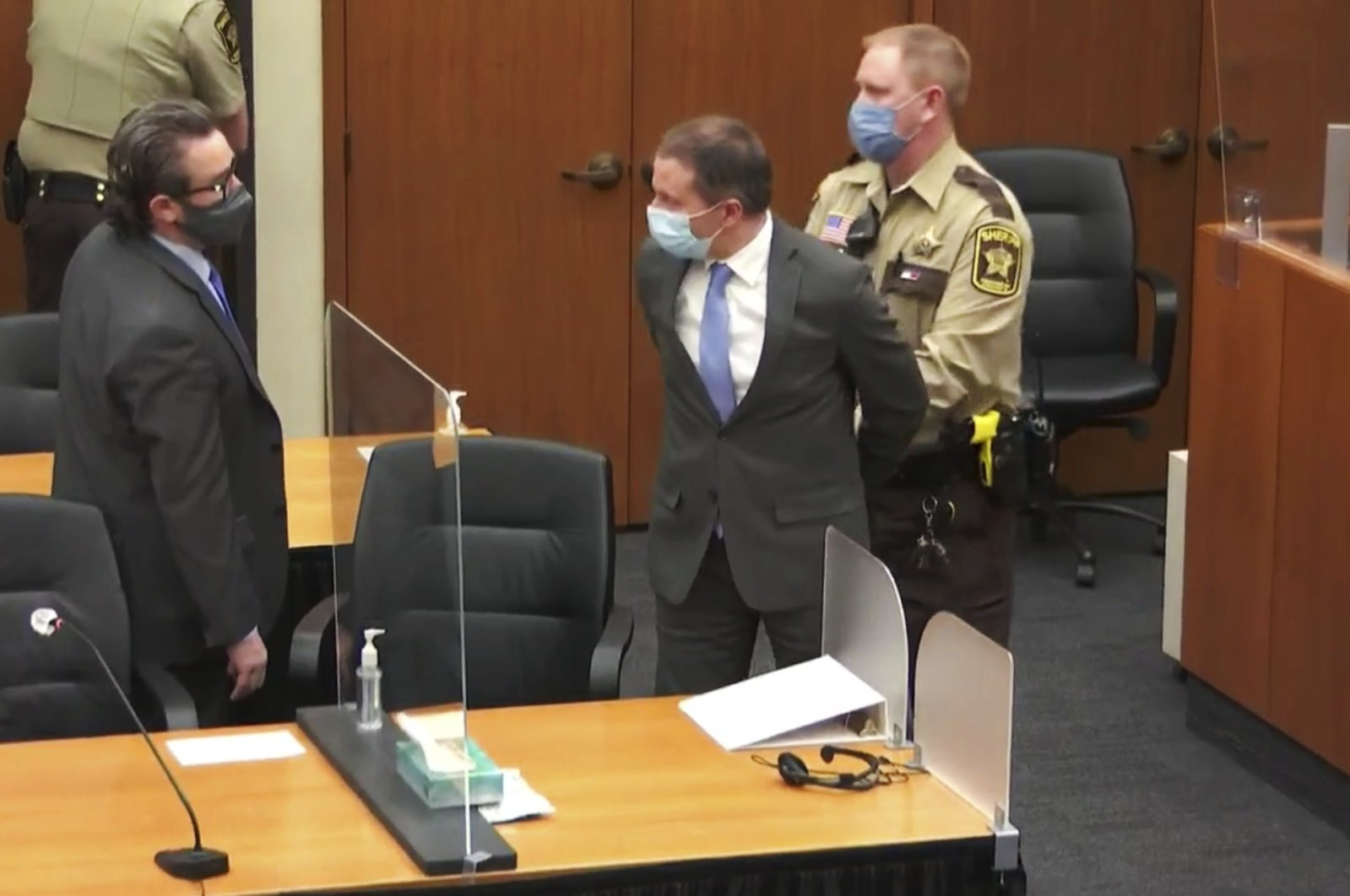 File image from video shows former Minneapolis police Officer Derek Chauvin (C) is taken into custody as his attorney, Eric Nelson (L) looks on, after the verdicts were read at Chauvin's trial for the 2020 death of George Floyd, at the Hennepin County Courthouse in Minneapolis, Minnesota, U.S., April 20, 2021. (AP Photo)