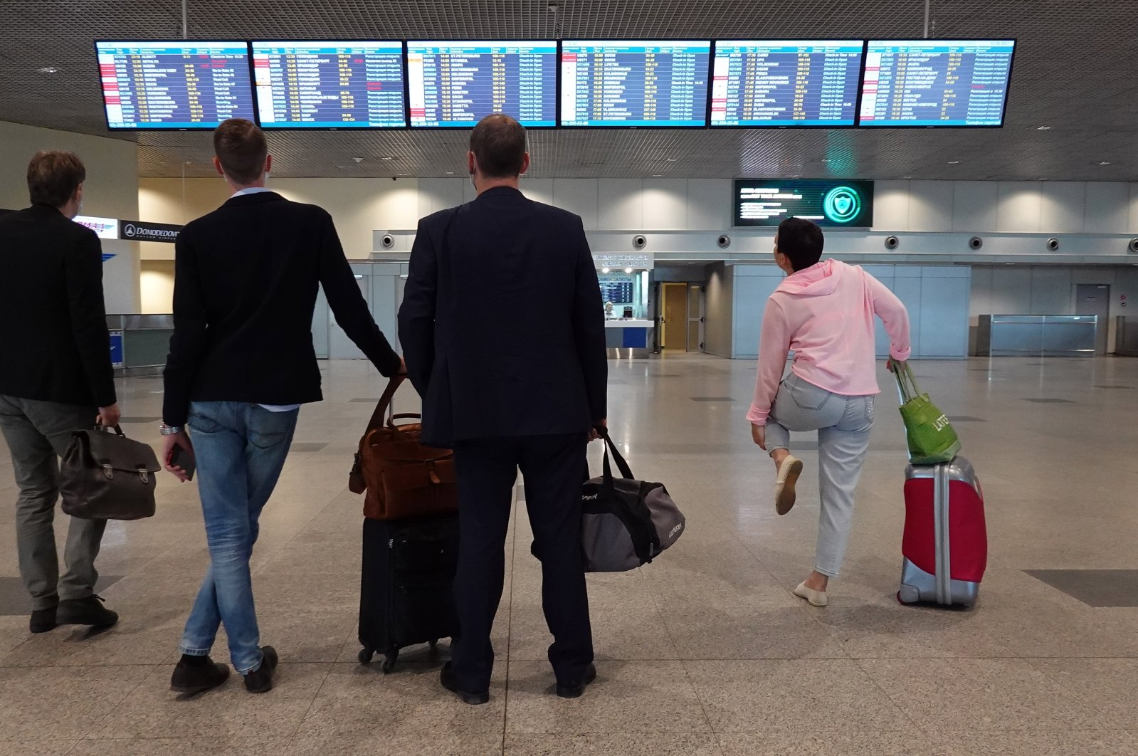 People look at the information board at Domodedovo Airport in Moscow, Russia, June 2, 2021. (EPA Photo)
