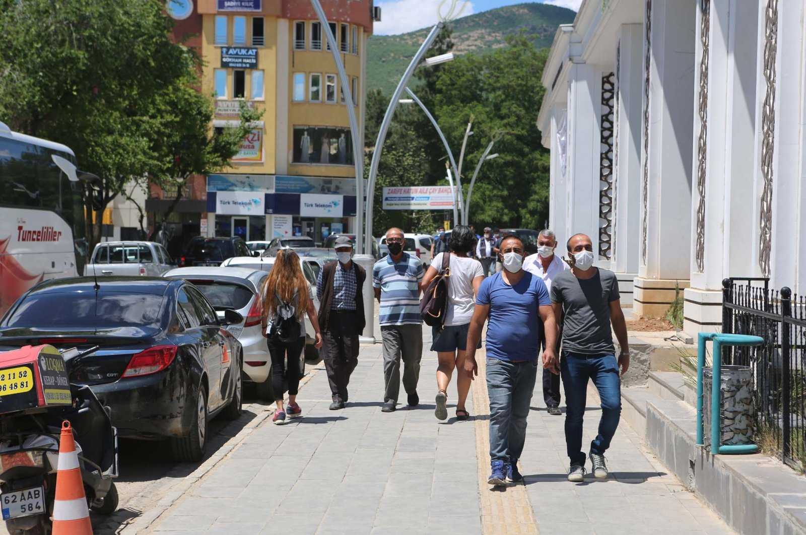 People wearing protective masks walk on a street in Tunceli, eastern Turkey, June 2, 2021. (DHA PHOTO)