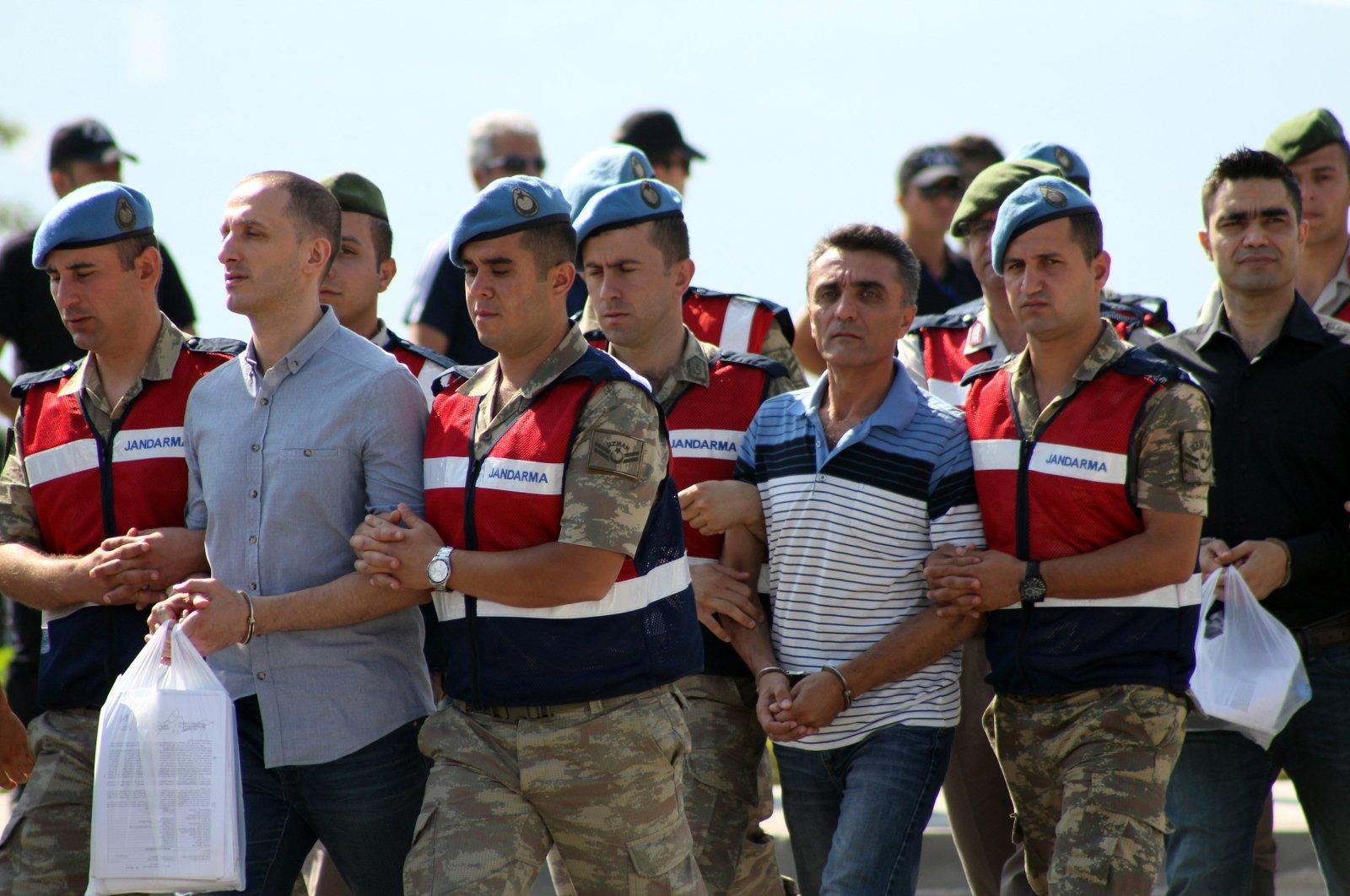 Gendarmerie officers escort defendants in the case to the courthouse, in Muğla, southwestern Turkey, July 21, 2017. (İHA PHOTO)
