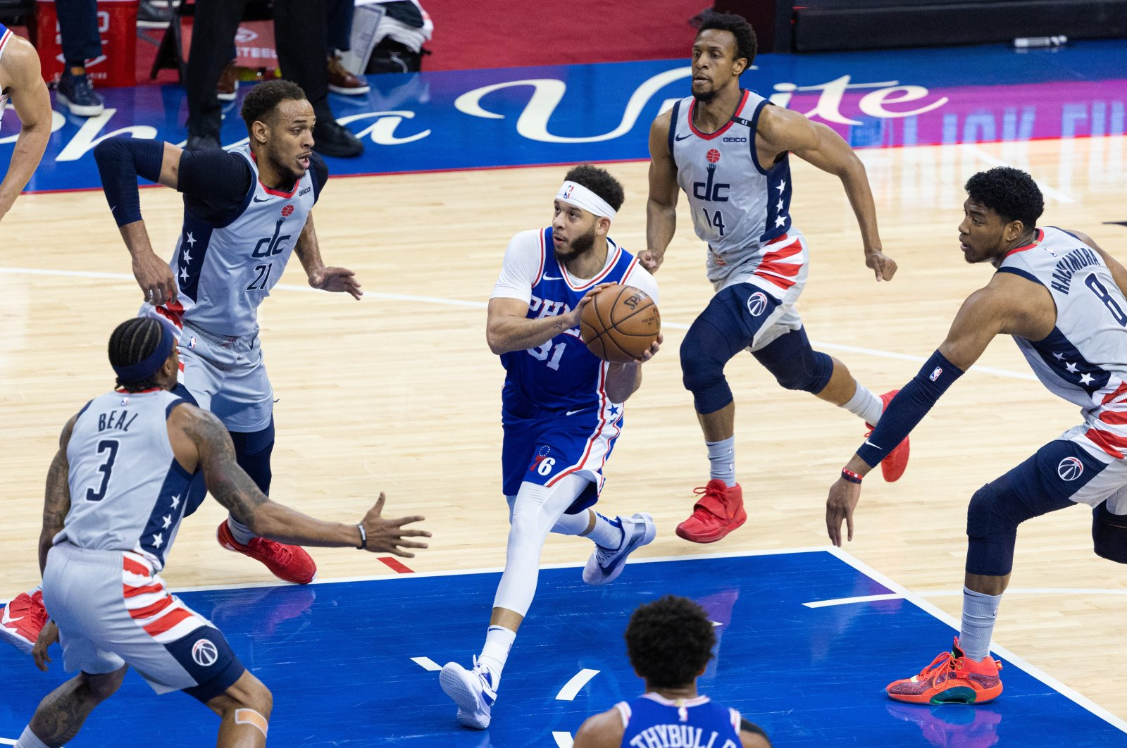 Philadelphia 76ers guard Seth Curry (C) drives for a shot against Washington Wizards guard Bradley Beal (L) and center Daniel Gafford (2nd L) during game five of their first-round NBA Playoffs at Wells Fargo Center, Philadelphia, Pennsylvania, U.S., June 2, 2021.