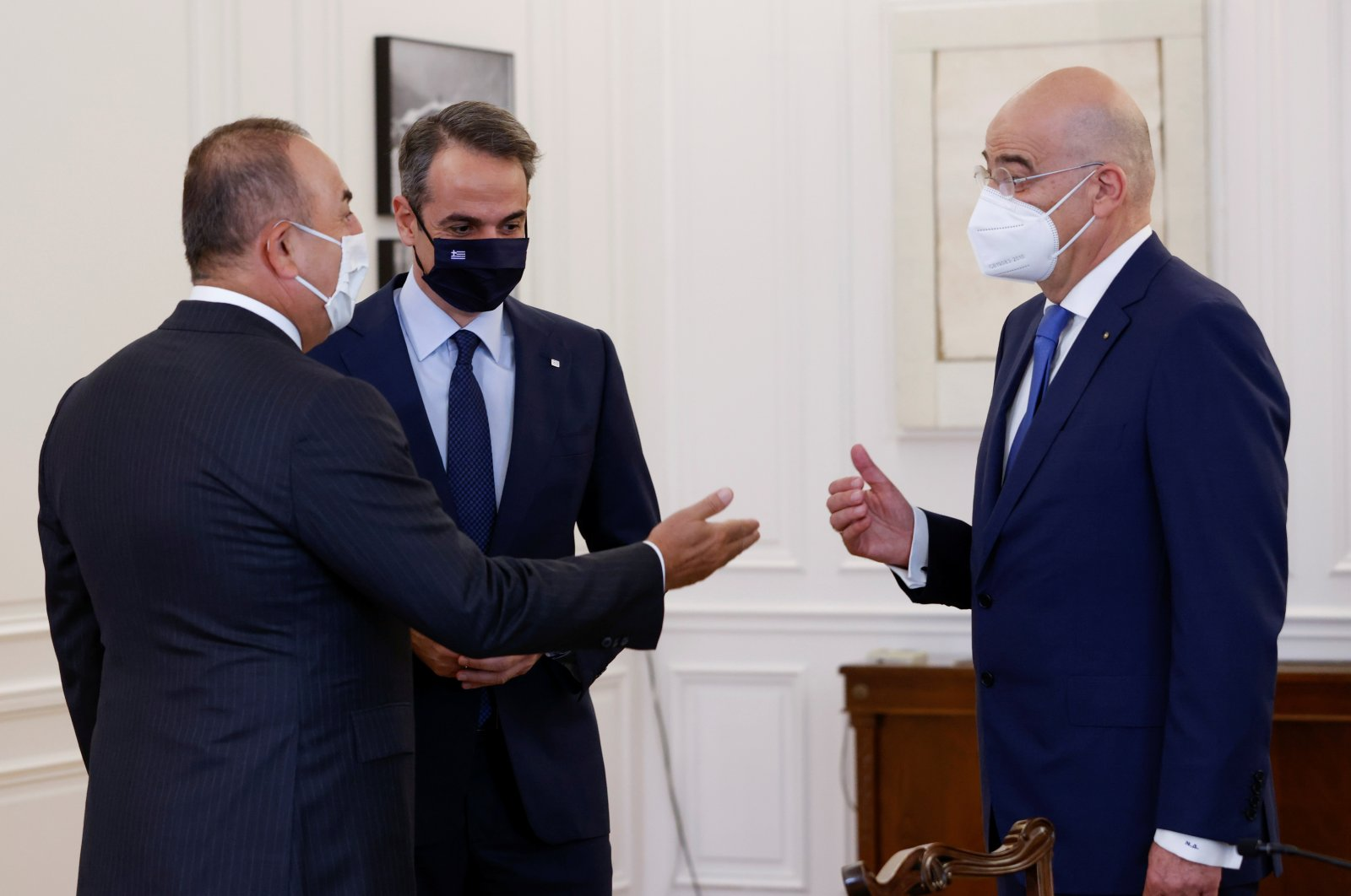 Turkish Foreign Minister Mevlüt Çavuşoğlu (L), Greek Prime Minister Kyriakos Mitsotakis (C) and Greek Foreign Minister Nikos Dendias meet at the Maximos Mansion in Athens, Greece, May 31, 2021. (REUTERS Photo)