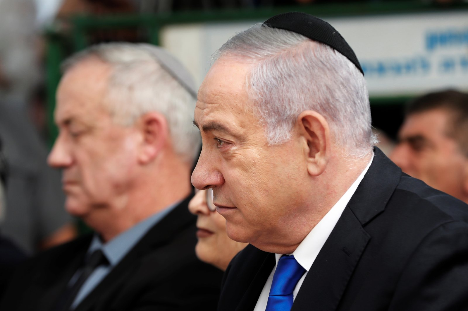 Israeli Prime Minister Benjamin Netanyahu looks on as he sits next to Benny Gantz, leader of Blue and White party, during a memorial ceremony for late Israeli President Shimon Peres, at Mount Herzl in Jerusalem, Israel, Sep. 19, 2019. (Reuters Photo)