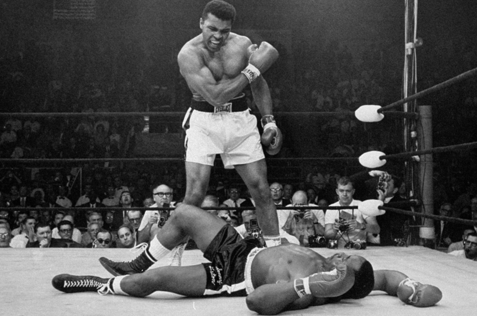 Heavyweight champion Muhammad Ali stands over fallen challenger Sonny Liston shortly after dropping him with a short hard right to the jaw in Lewiston, Maine, U.S., May 25, 1965.