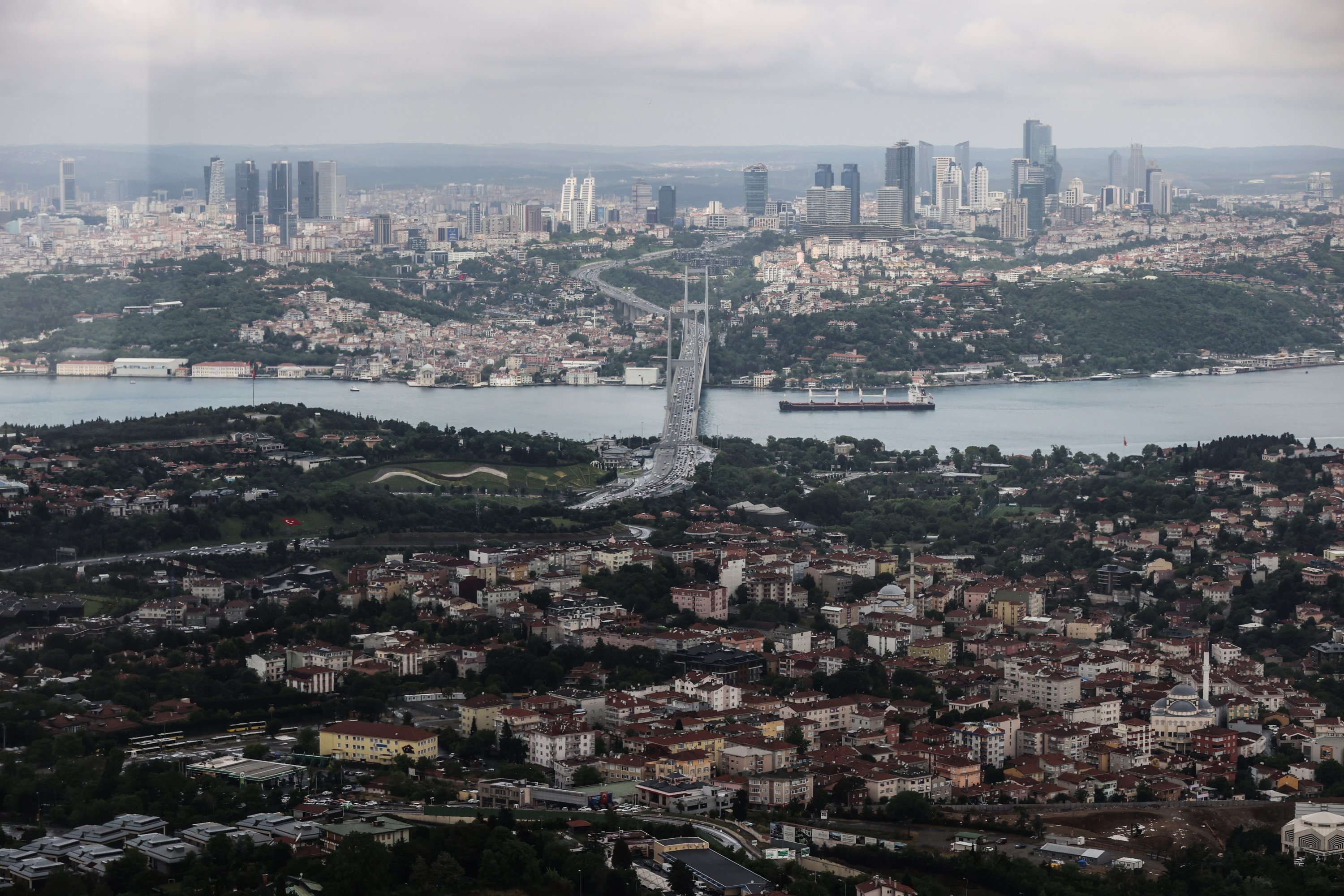 The view of the Bosporus, the July 15 Martyrs Bridge and the city skyline from an observation deck at the Çamlıca Tower, in the Üsküdar district, Istanbul, Turkey, June 1, 2021.