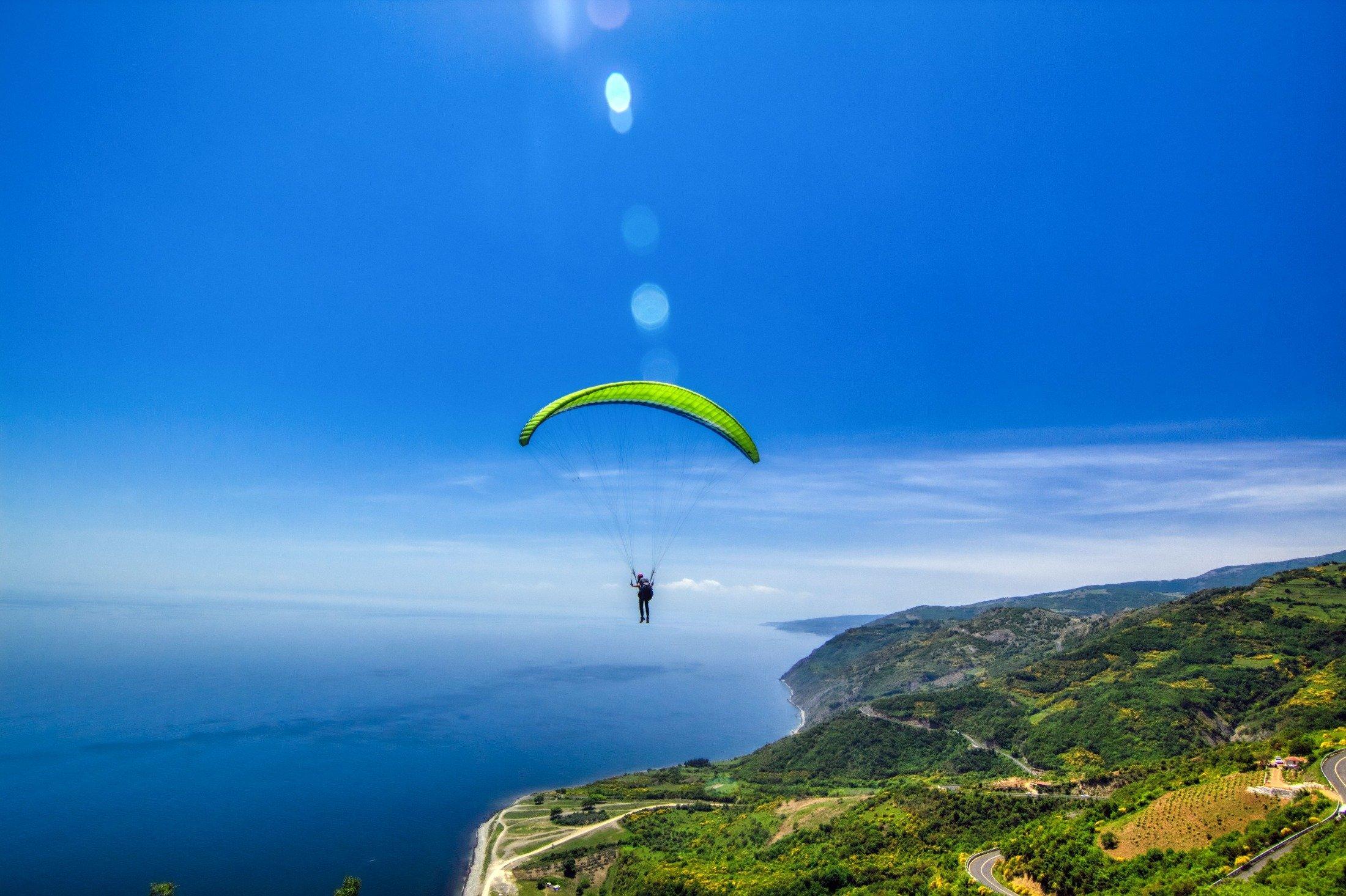 A man paraglides from Mount Ganos