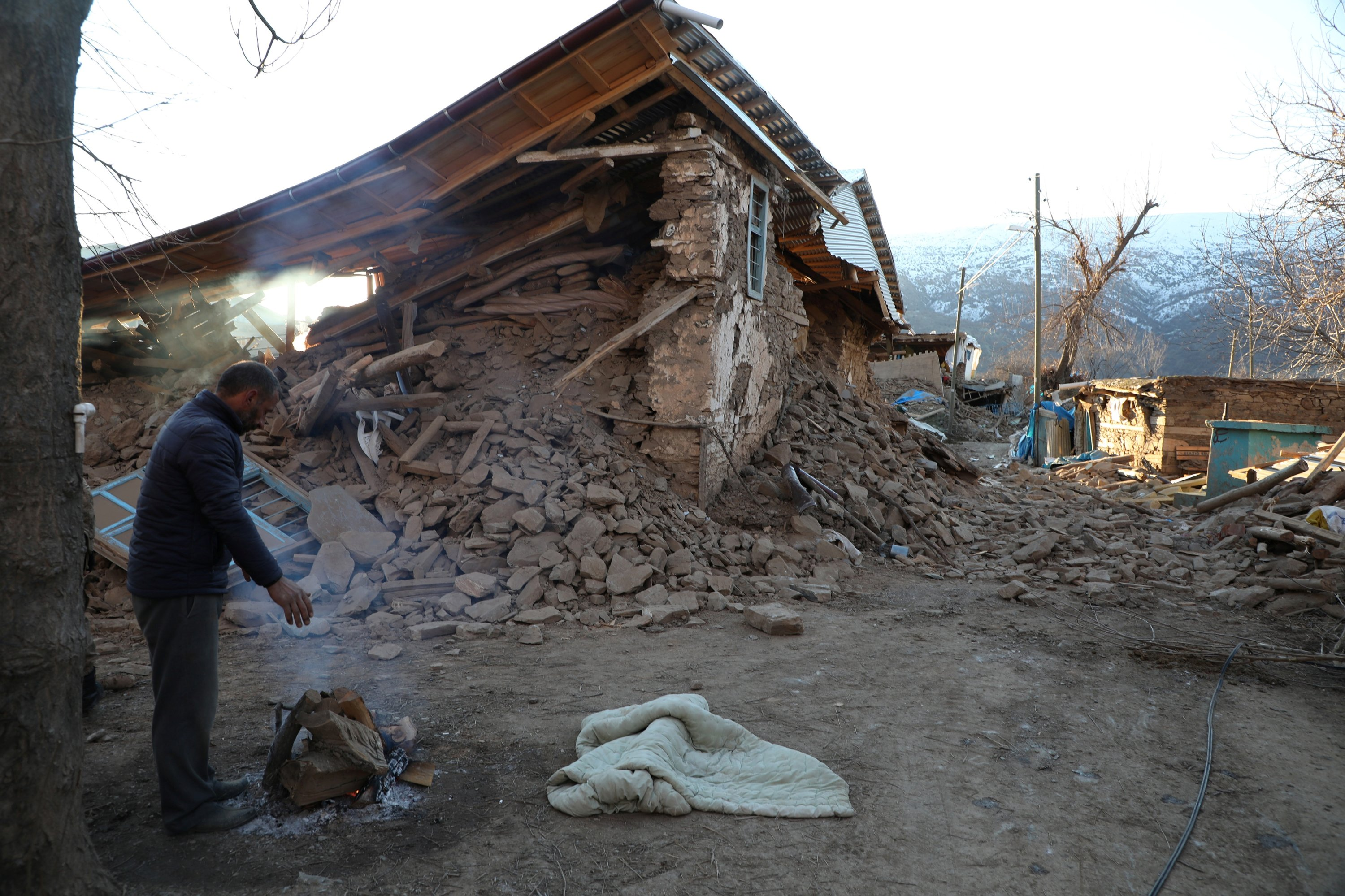 A villager stands next to his collapsed house after an earthquake in Sivrice near Elazığ, Turkey, Jan. 25, 2020. (Reuters Photo)